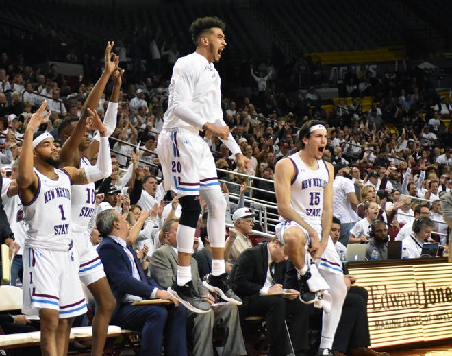 The NMSU Aggie bench celebrates after a teammate sinks a 3-point shot against Grand Canyon University on Thursday, Jan. 10, 2019, at the Pan Am Center.  The Aggies would win 77-75 on a Johnny McCants half-court shot at the buzzer.