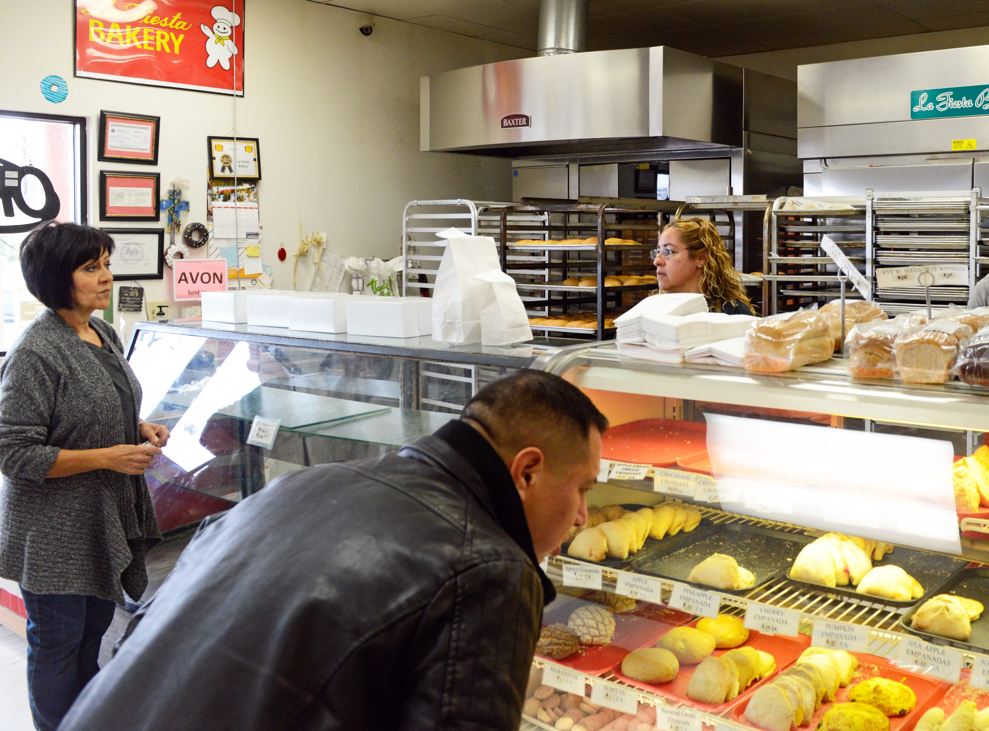 La Fiesta Bakery staff wait on customers at the bakery on January 10, 2019.
