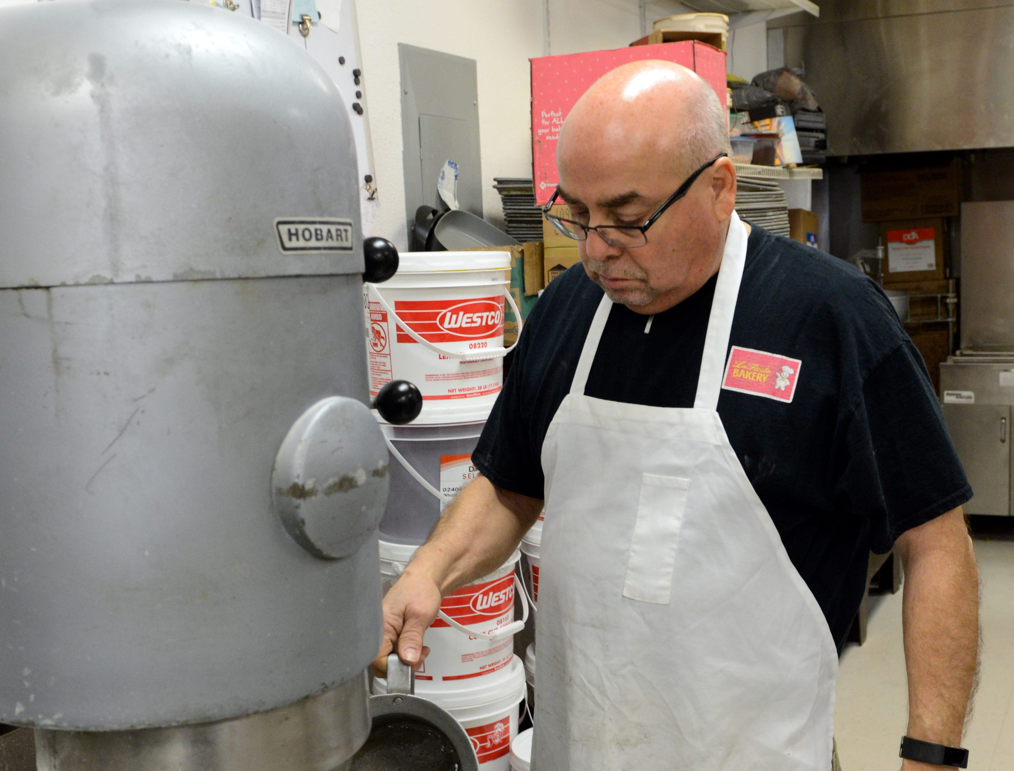 Ray Ortega, who owns La Fiesta Bakery with his wife Gina, makes bolillo dough at the bakery on January 10, 2019.