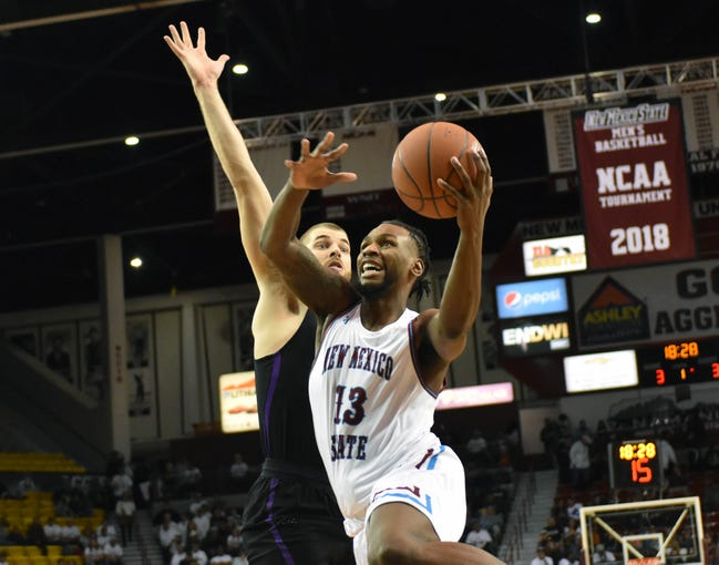 New Mexico State's C.J. Bobbitt goes up with his left hand for a lay up during Thursday night's game against Grand Canyon University at the Pan American Center.