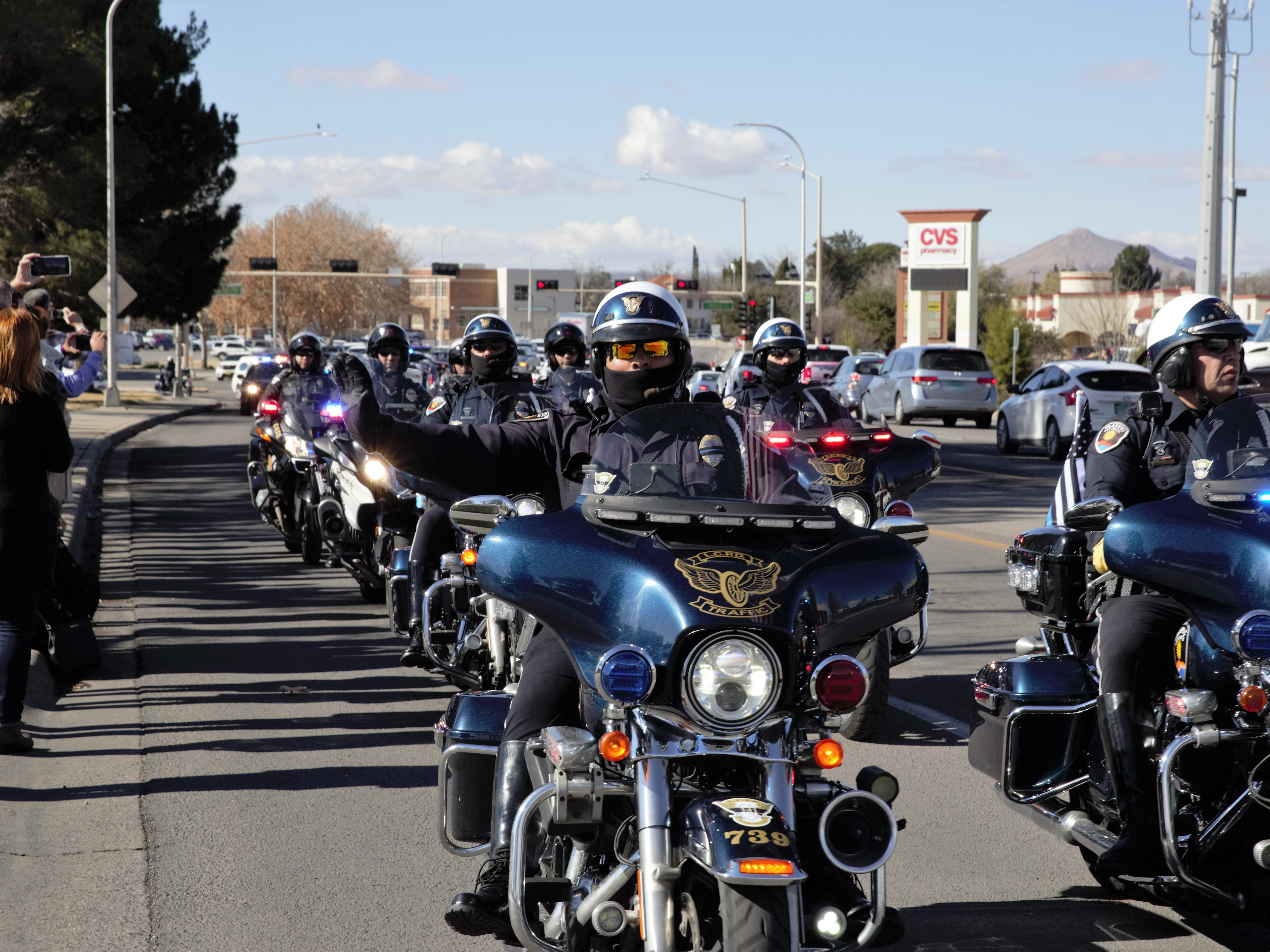 Las Cruces Police Department motorcycle officers lead a funeral procession on Picacho Avenue on Friday, Jan. 11, 2019 for former LCPD police Chief Jaime Montoya.