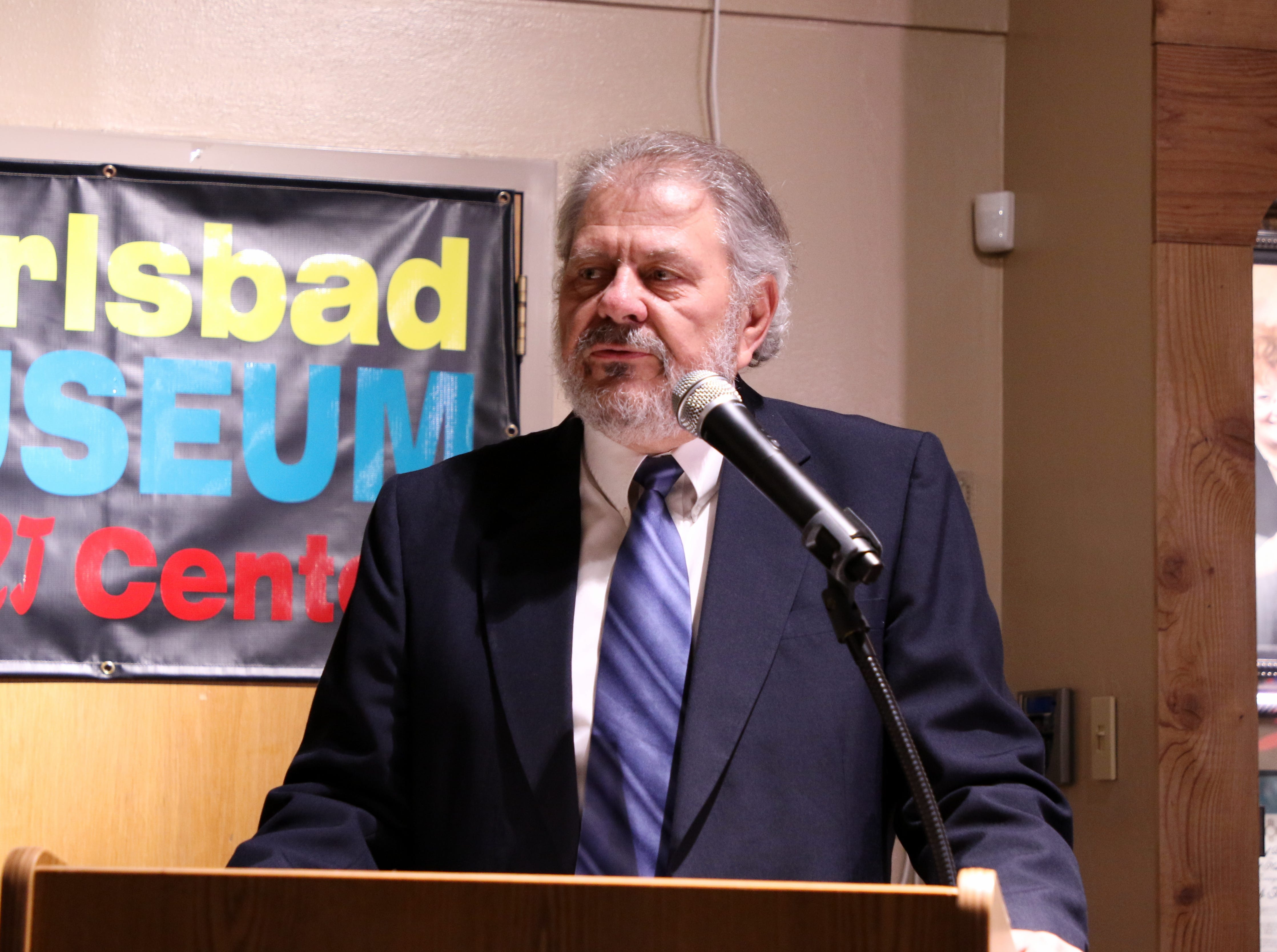 Ken Britt, the master of ceremonies, talks during Friday's Carlsbad Hall of Fame Induction.