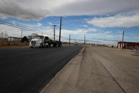 A large truck heads east on Derrick Road. The estimated cost of the project is $3.9 million.