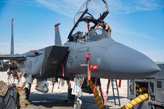 """Members of the 332d Air Expeditionary Wing, 391st Fighter Squadron """"Bold Tigers,"""" inspect different areas of an F-15 to ensure it is ready for its next flight Jan. 5, 2019, at an undisclosed location in Southwest Asia. The """"Tigers"""" are capable of employing a full array of United States Air Force weaponry including air-to-air missiles, 20mm gun, laser-guided munitions, Global Positioning Satellite guided munitions, general purpose munitions, and stand-off weapons. The 332 AEW is the premier provider of full-spectrum integrated air and space power in Southwest Asia."""