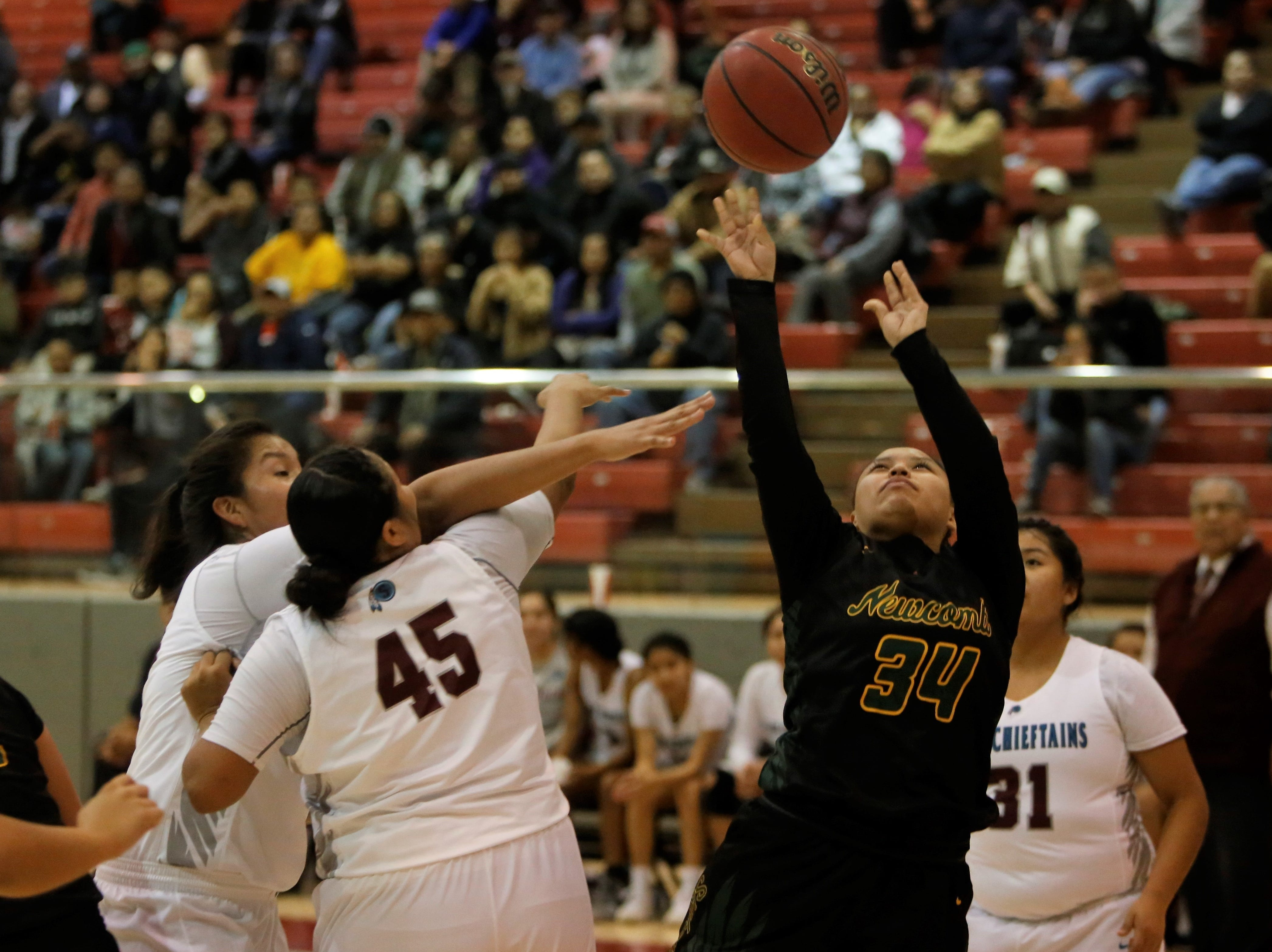 Newcomb's Bryanna Curley puts up a contested shot against Shiprock during Thursday's game at the Chieftain Pit in Shiprock.