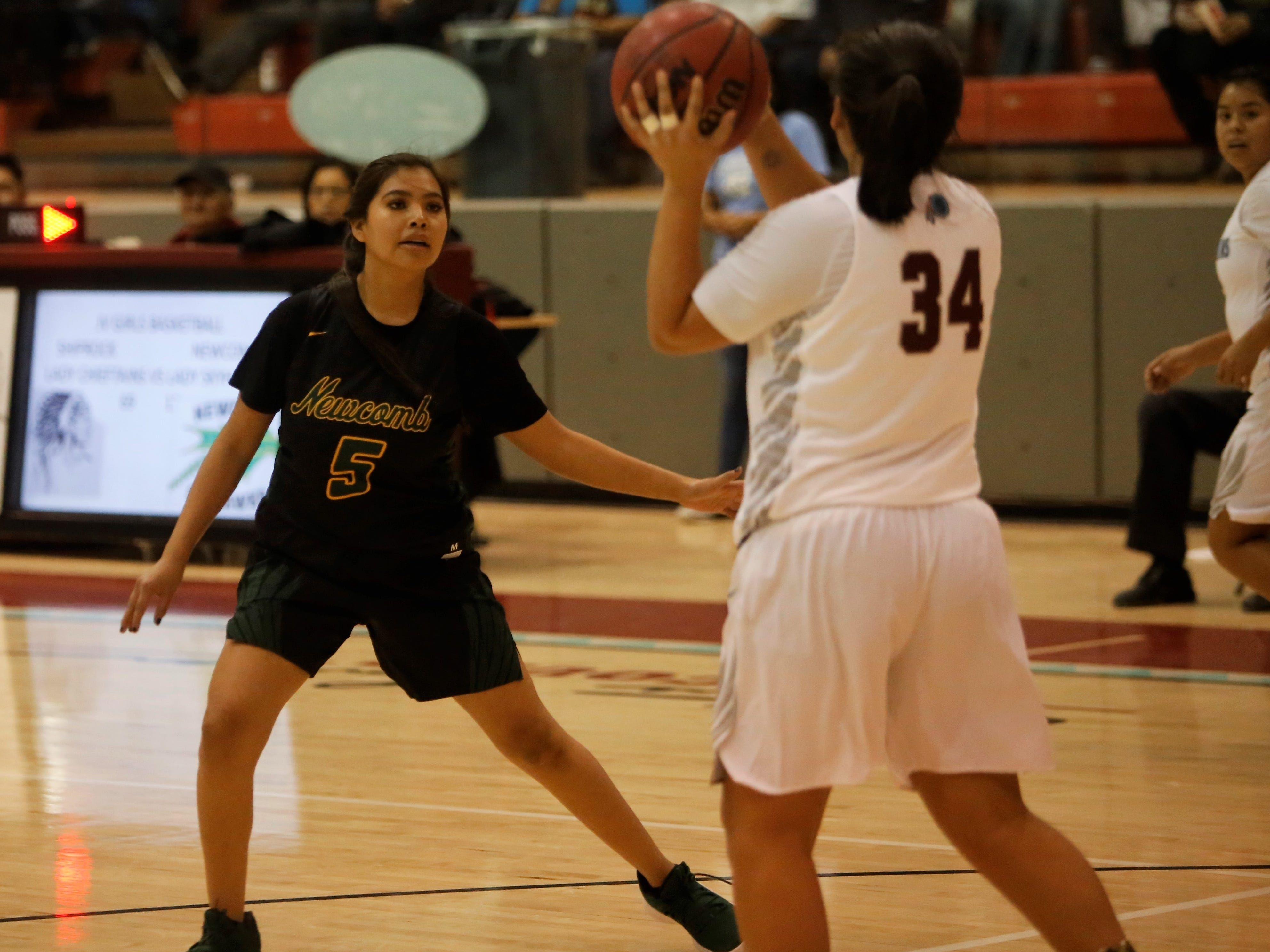 Newcomb's Autumn Manuelito looks to get a defensive stop against Shiprock's Tayya Dale during Thursday's game at the Chieftain Pit in Shiprock.