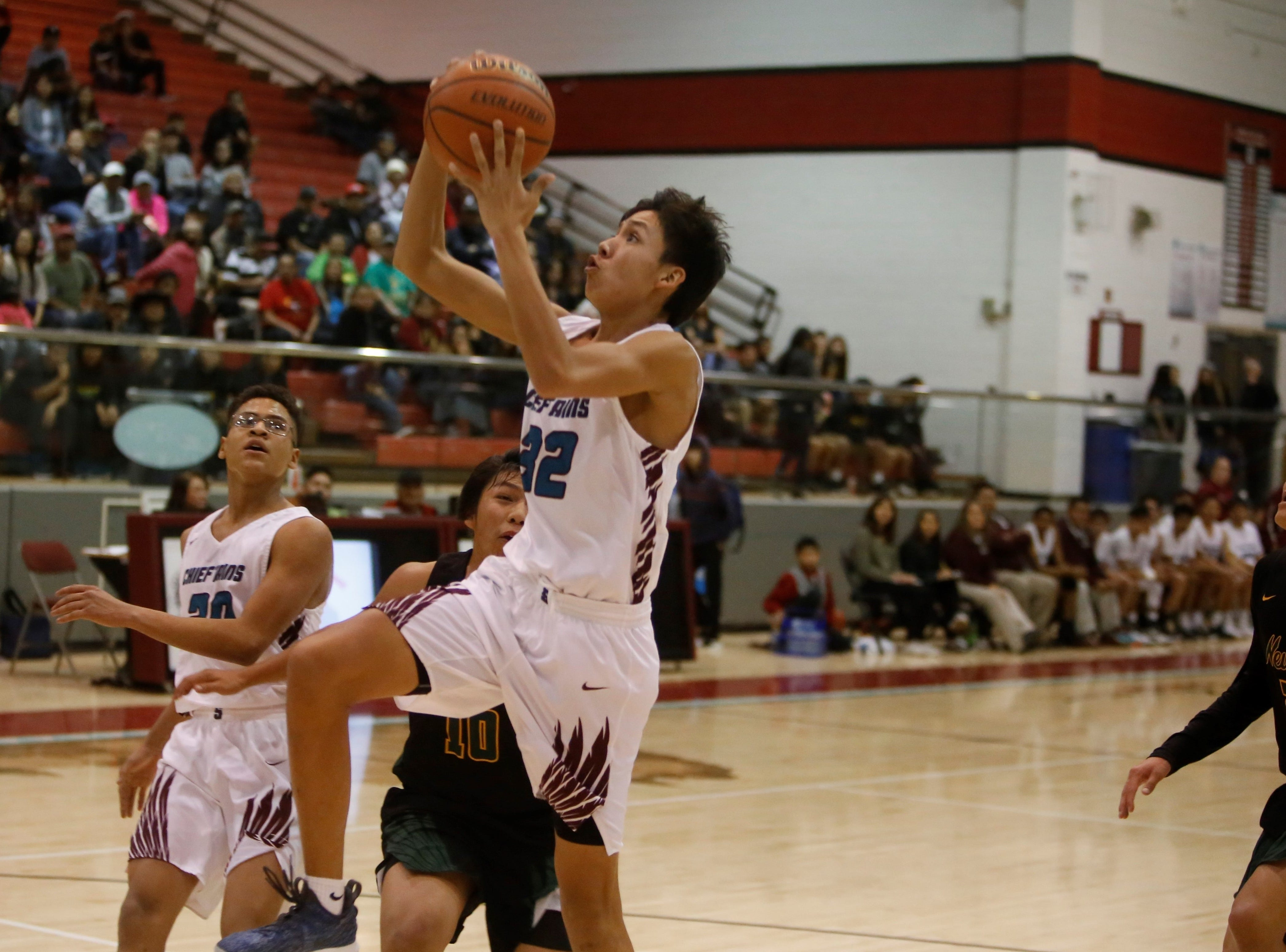 Shiprock's Shannon Dale drives to the basket against Newcomb during Thursday's game at the Chieftain Pit in Shiprock.