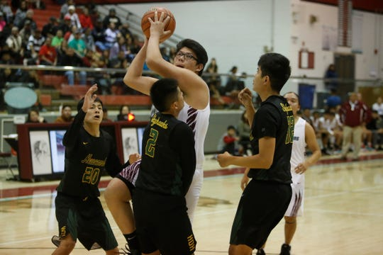 Shiprock's Eeyan John bumps into Newcomb's Deion Johnhat (2) driving to the basket for a layup during Thursday's game at the Chieftain Pit in Shiprock. Visit daily-times.com to see the latest sports photo galleries and video highlights.