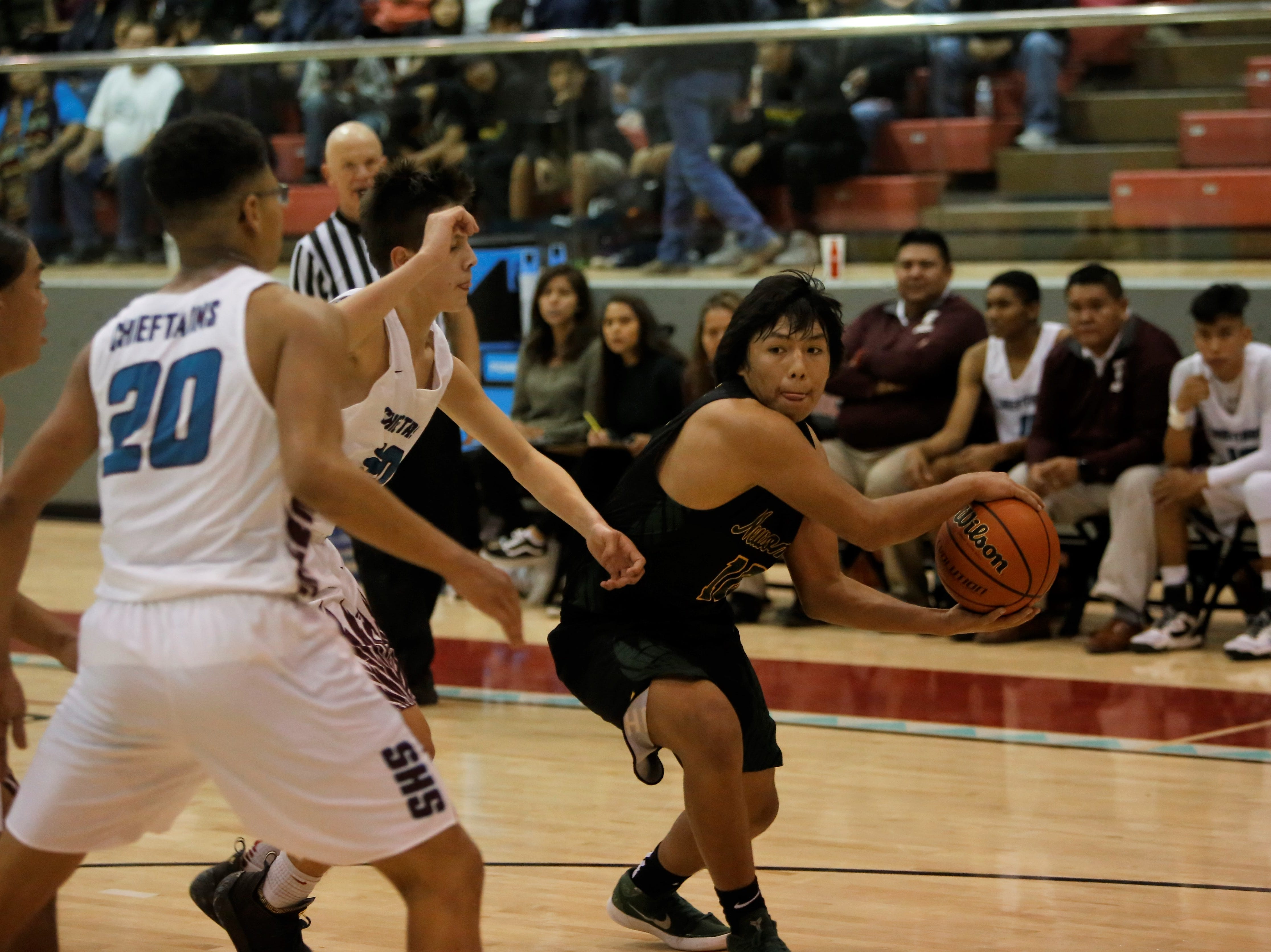 Newcomb's Kelkenny Watchman makes a bounce pass into the post against Shiprock during Thursday's game at the Chieftain Pit in Shiprock.