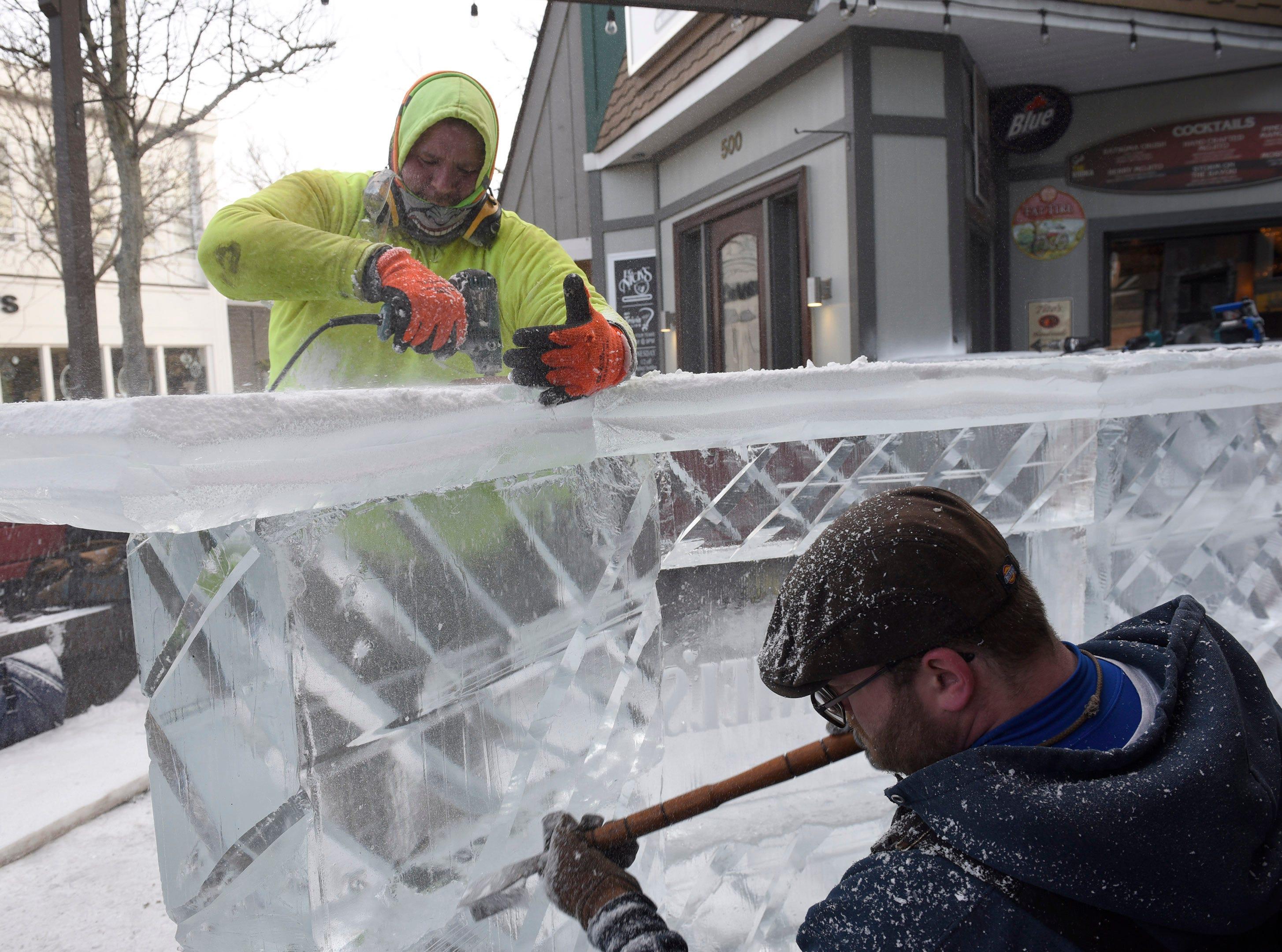 Chris Busuash and Paul Nuznov work on the ice bar at E.G. Nicks.