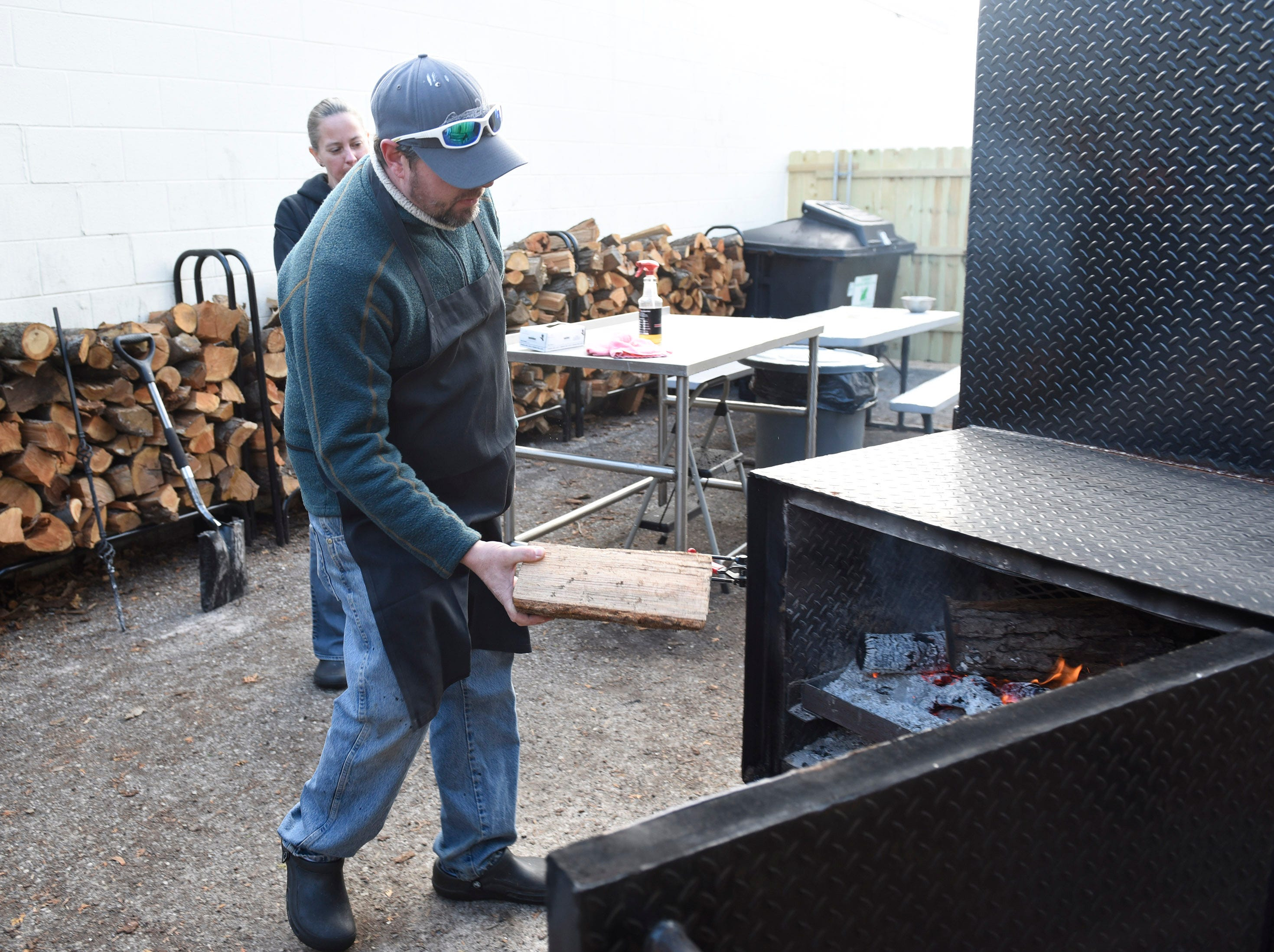 Aaron Peggs uses Michigan cherry or apple wood in the smoker.