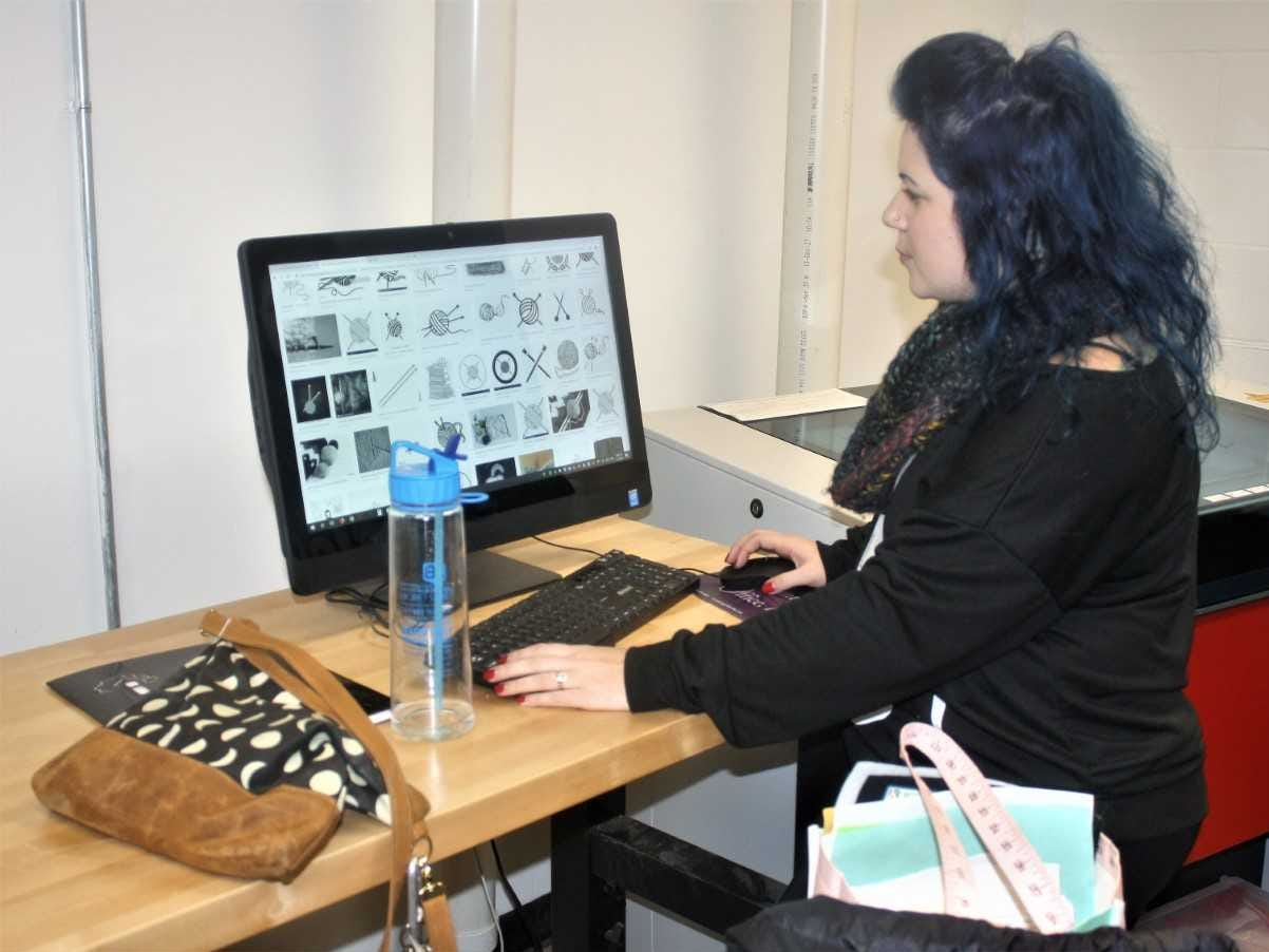 Jenna Woodcox utilizes the high-tech offerings at Village Workshop.