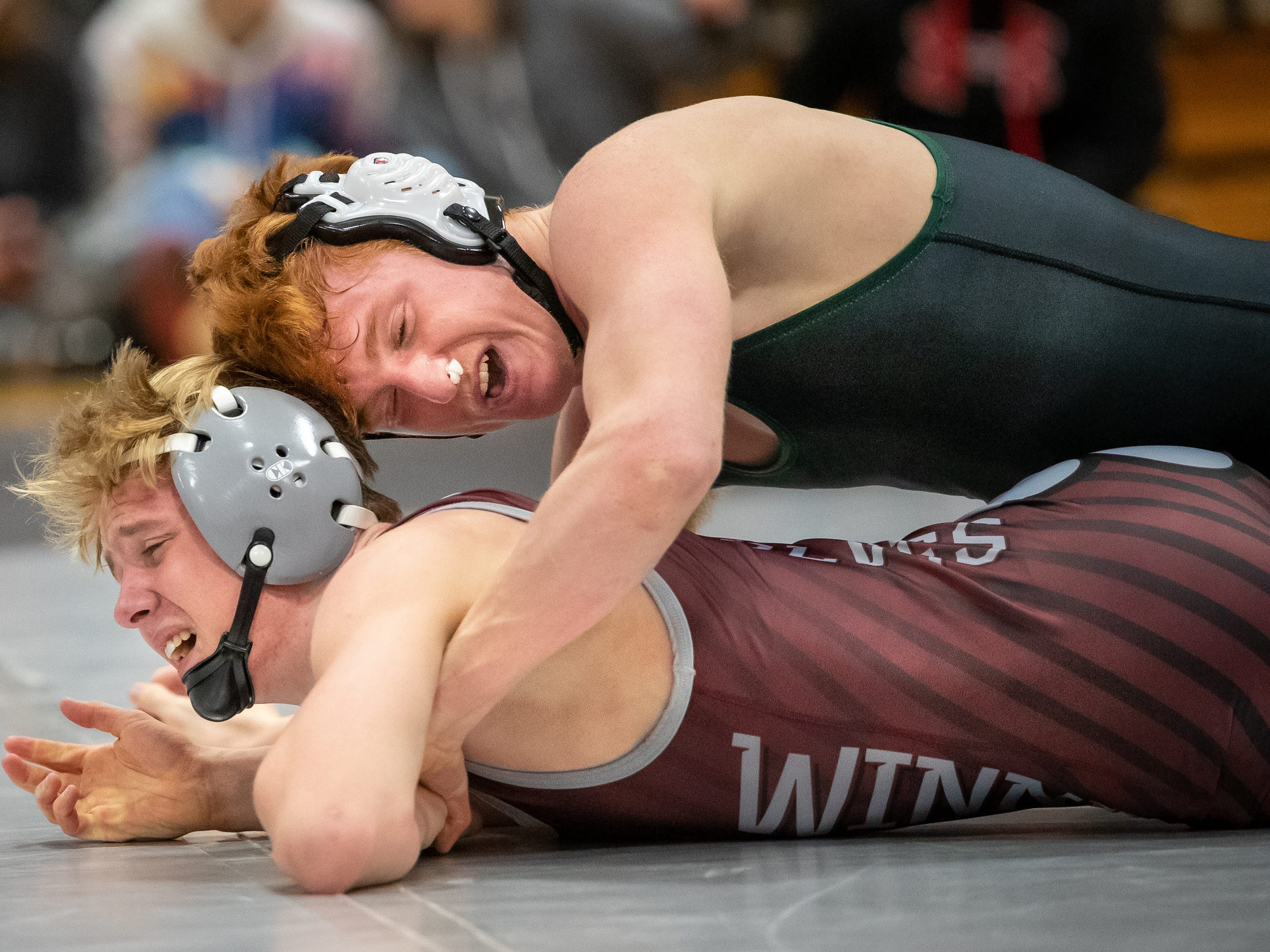 Jacob Larsen of Winneconne wrestles Scott McGibbon of Berlin in the 132-pound weight class. The Winneconne Wolves hosted the Berlin Indians in an East Central Conference wrestling match Thursday evening, January 10, 2018.