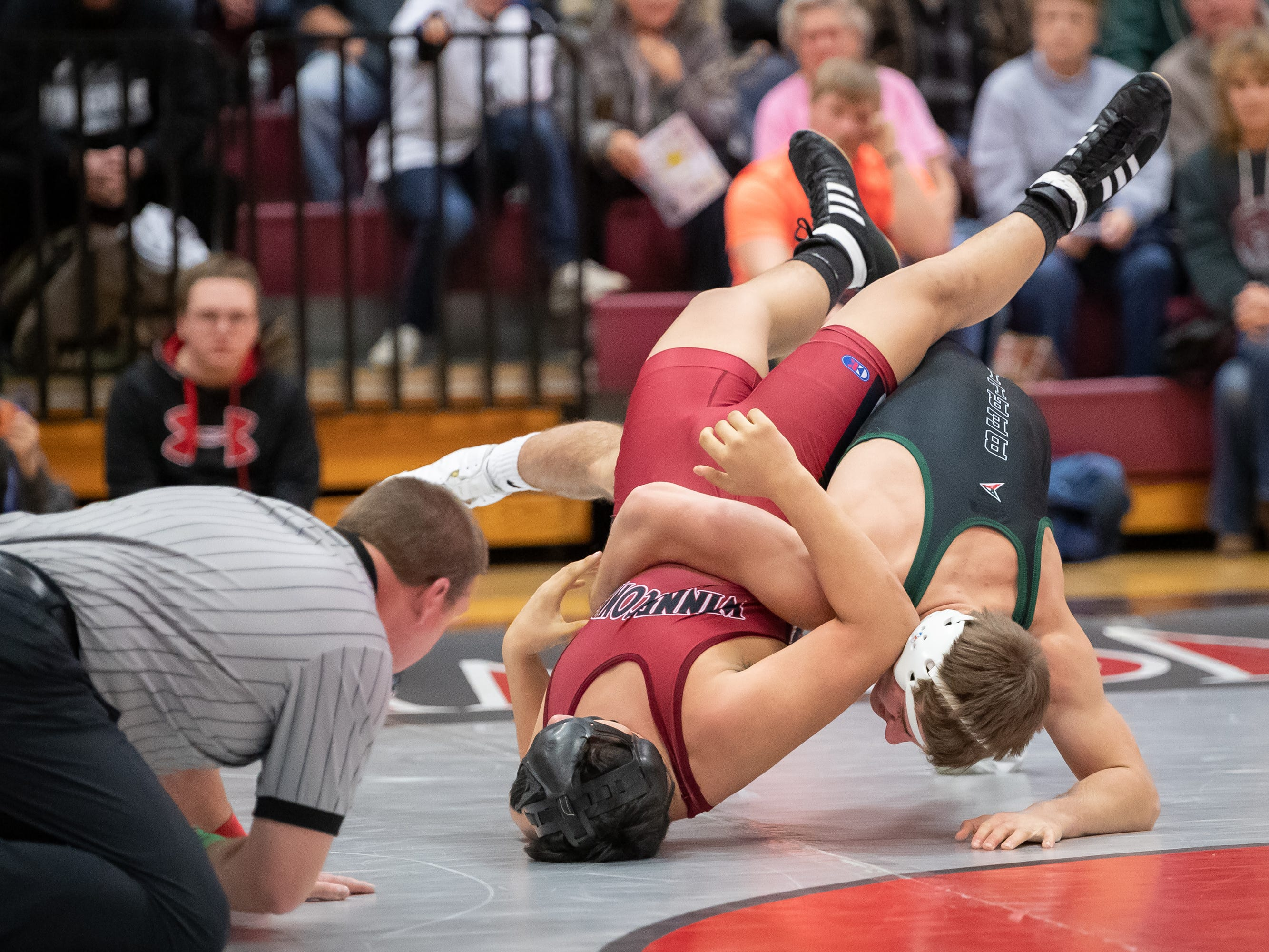 William Spanbauer of Winneconne wrestles Preston Morgan of Berlin in the 160-pound weight class. The Winneconne Wolves hosted the Berlin Indians in an East Central Conference wrestling match Thursday, Jan. 10, 2019.