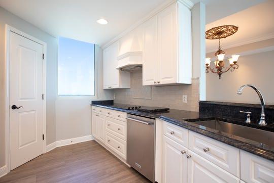 721 Pensacola Beach Boulevard - Verandas #601The kitchen includes stainless appliancea and abundant storage space.