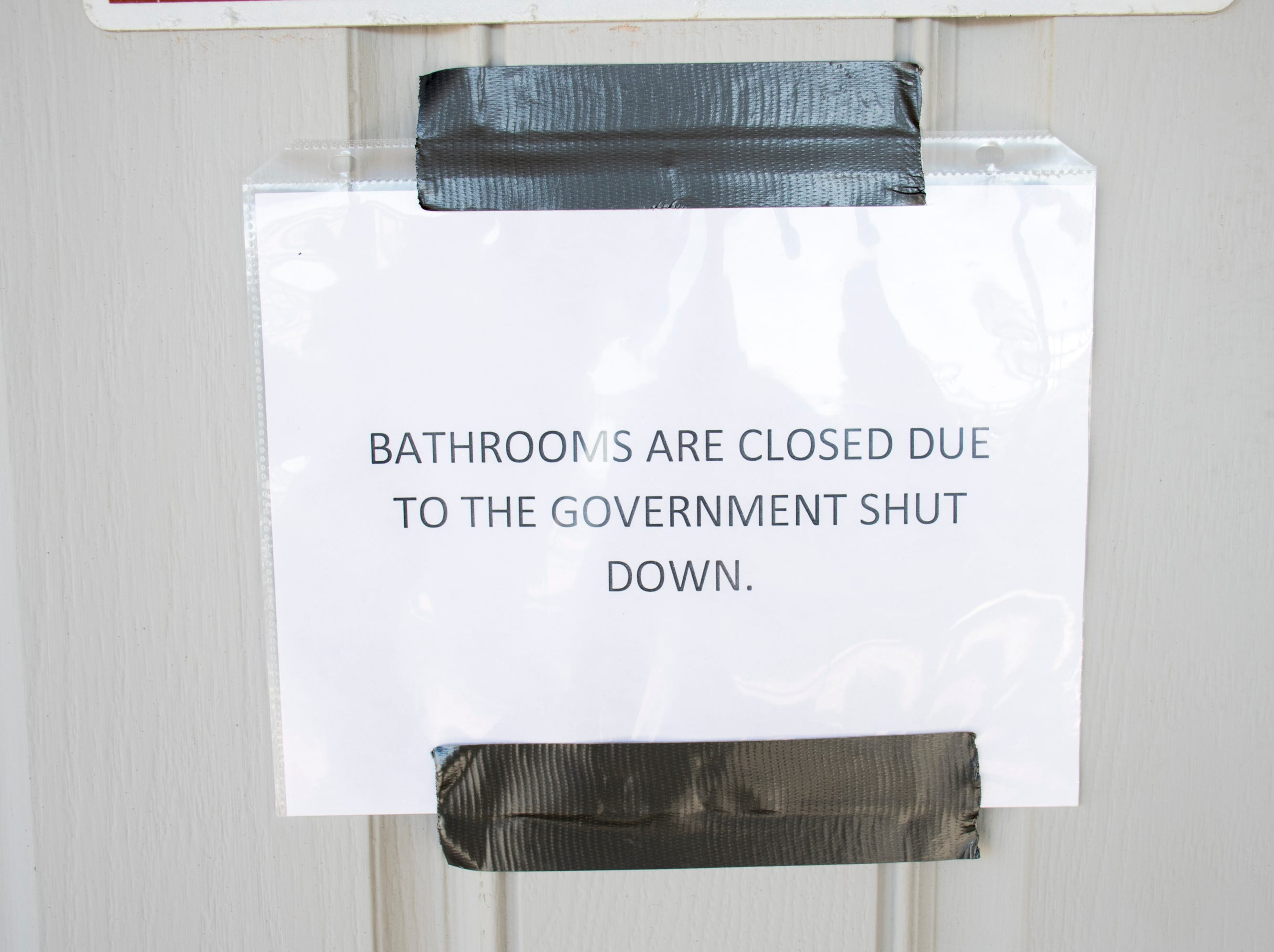 A sign lets visitors know that the bathrooms are closed due to the federal government shutdown at Gulf Islands National Seashore's Rosamond Johnson Beach in Perdido Key on Friday, January 11, 2019.