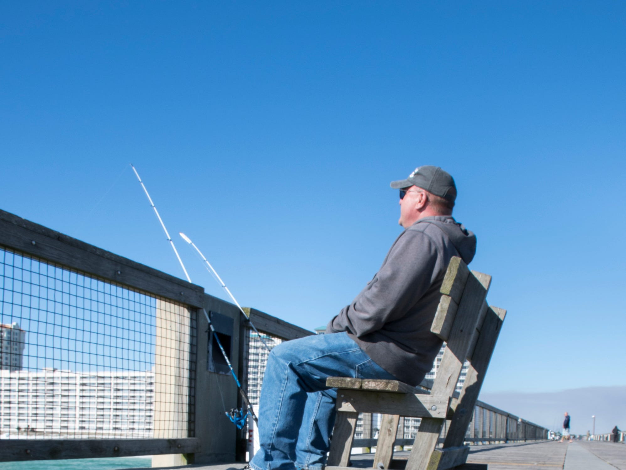 Angler Russ Kaiser, of Kansas City, Missouri, fishes from the pier in Navarre on Friday, January 11, 2019.  The pier is slated to get a major makeover this year complete with new decking material.