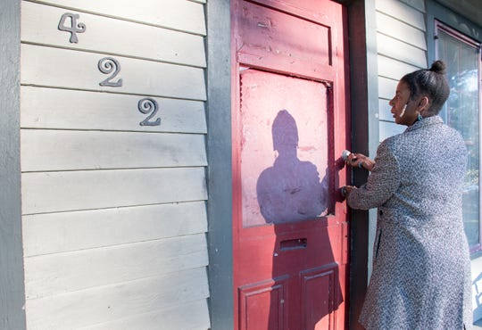 Robin Reshard locks up at 422 N. Coyle Street in the Belmont-DeVilliers neighborhood of Pensacola on Friday. The building will be the future home of the Ezra Gerry Museum and Research Center.