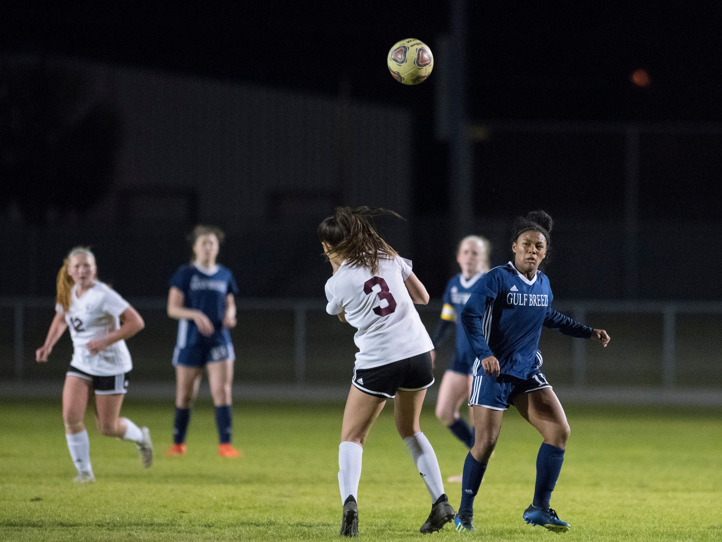 Mya Swinton (11) heads the ball past Brayden Thomas (3) during the Niceville vs Gulf Breeze soccer game at Gulf Breeze High School on Thursday, January 10, 2019.