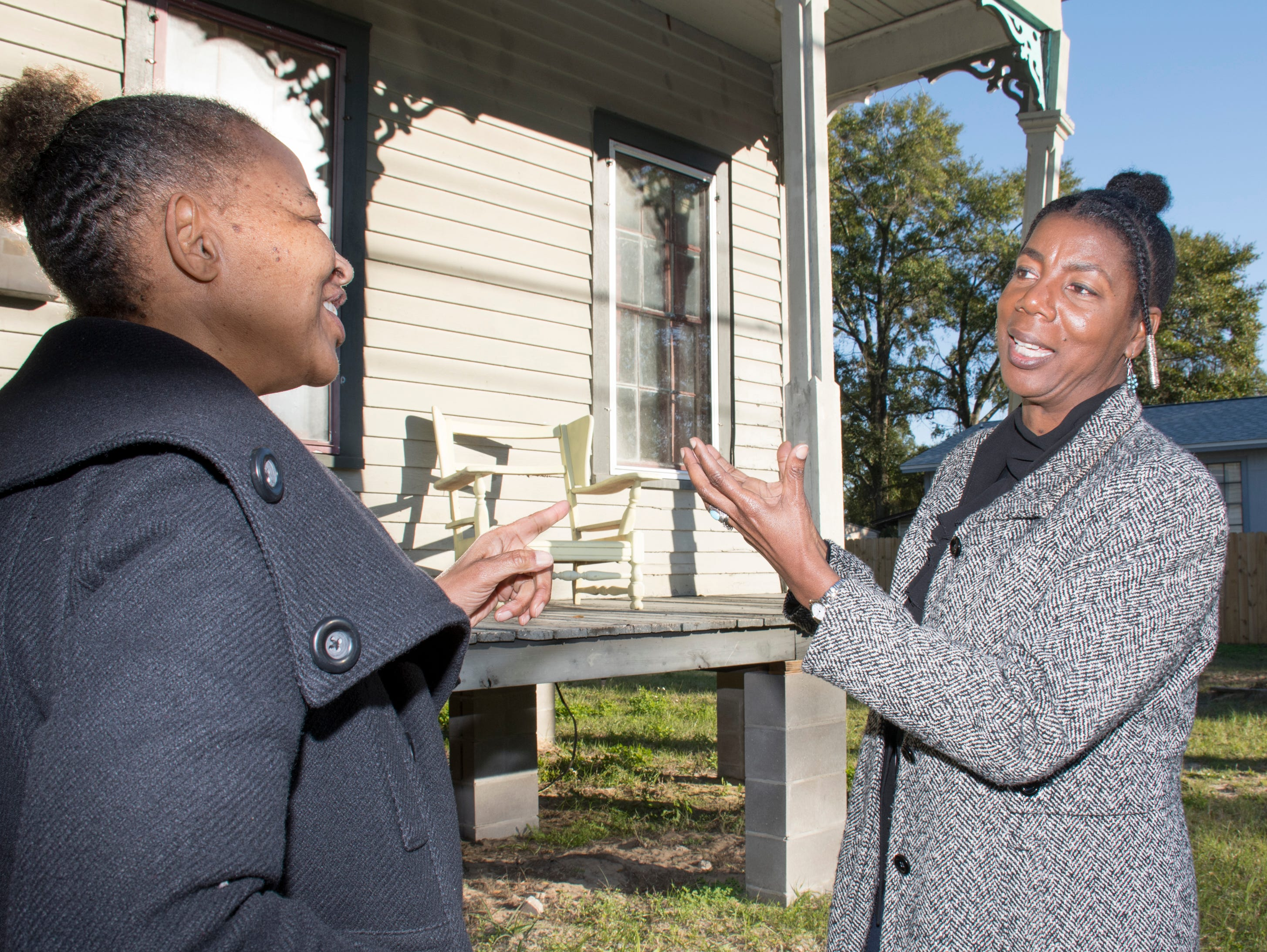 Robin Reshard, right, tells Caroll Hobbs about plans for the future home of the Ezra Gerry Museum and Research Center at 422 N. Coyle Street in the Belmont-DeVilliers neighborhood of Pensacola on Friday, January 11, 2019.