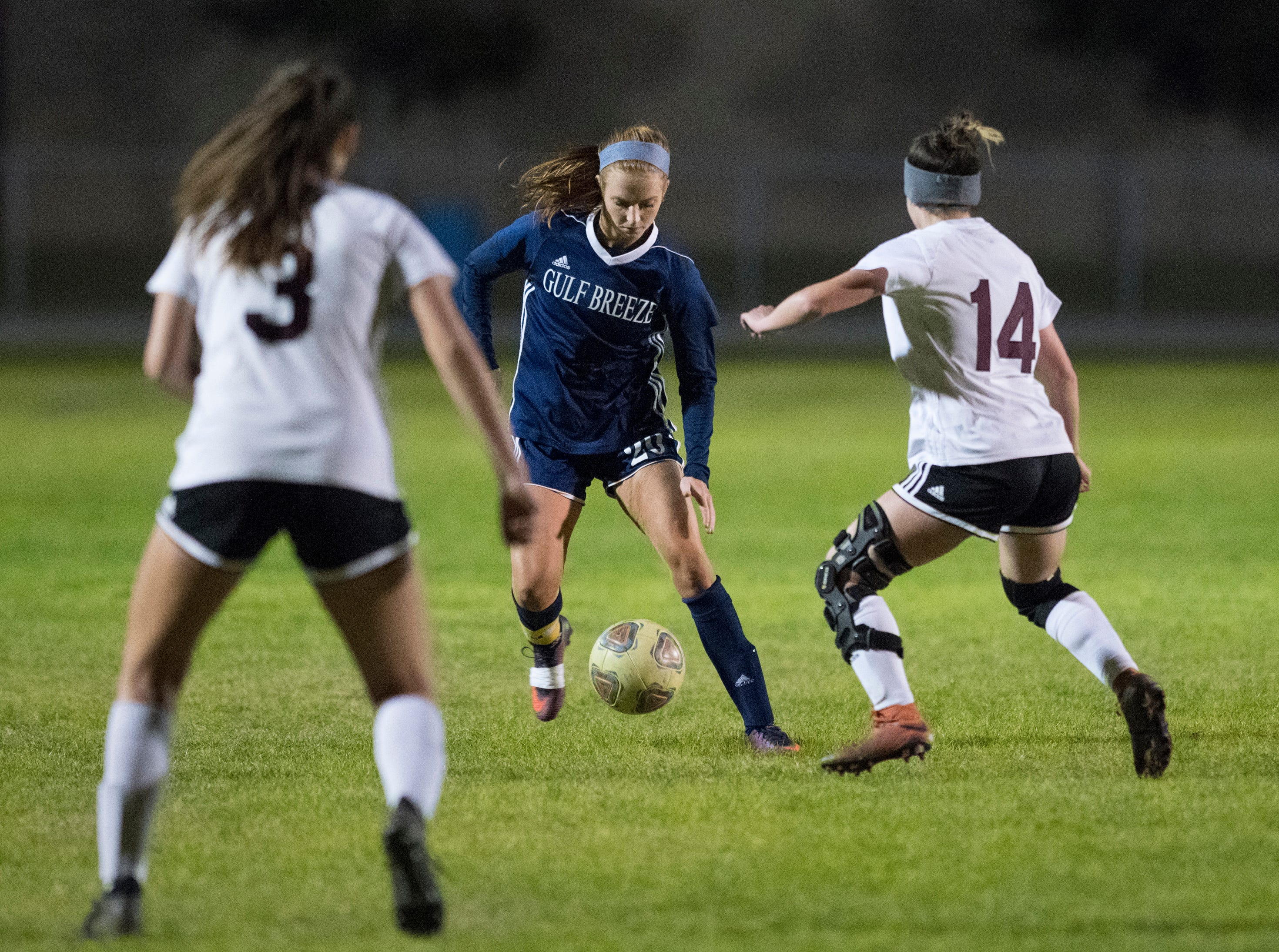 Kristen Goodroe (20) dribbles the ball during the Niceville vs Gulf Breeze soccer game at Gulf Breeze High School on Thursday, January 10, 2019.