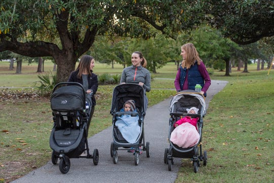 Melissa Benator, Audrey Kercher and MaryTaylor Tew walk Bayview Park with their children.