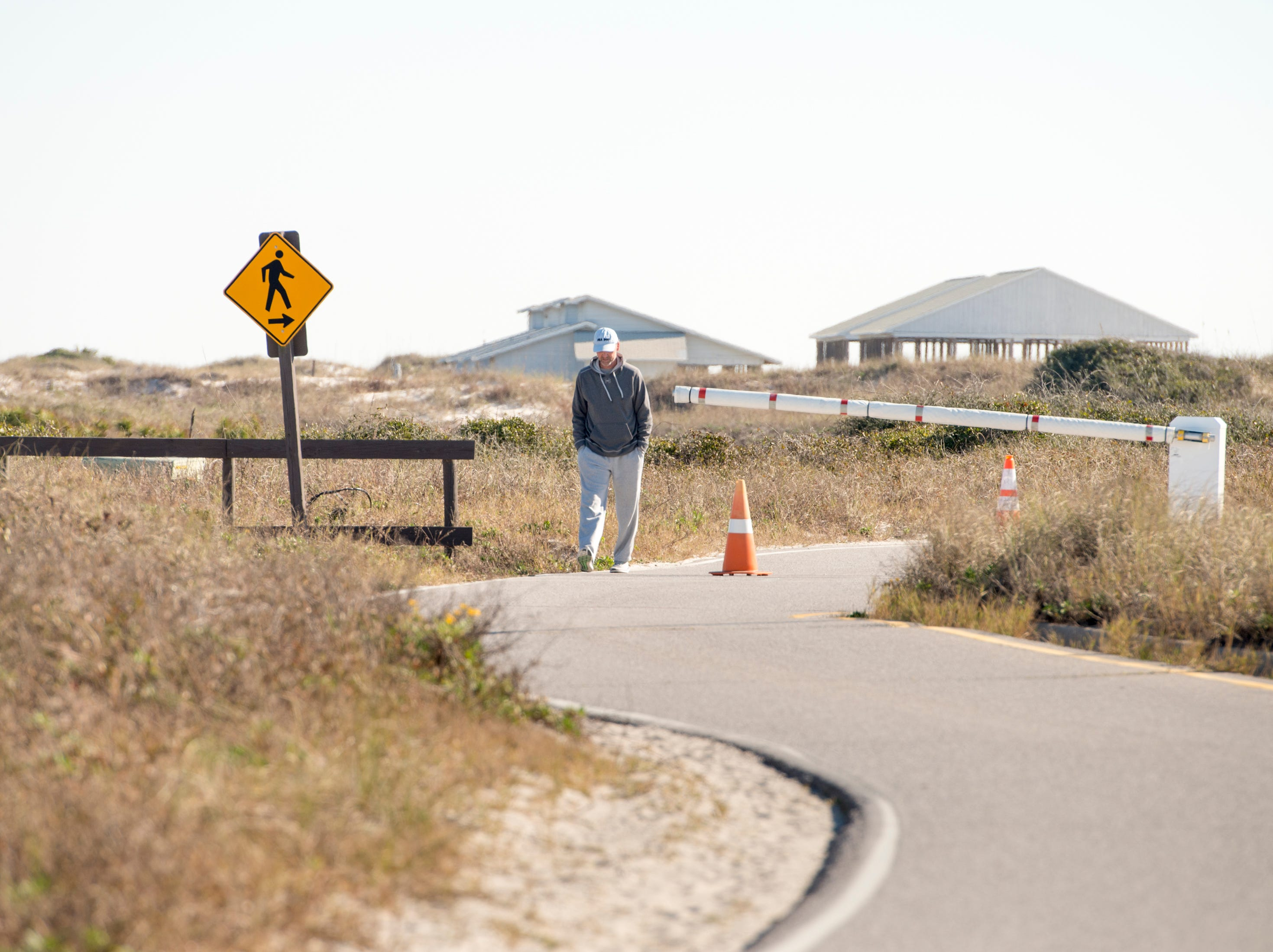 Richard Morrison, of Michigan, walks along the road at Gulf Islands National Seashore's Rosamond Johnson Beach in Perdido Key on Friday, January 11, 2019.  The National Park is closed due to the federal government shutdown.