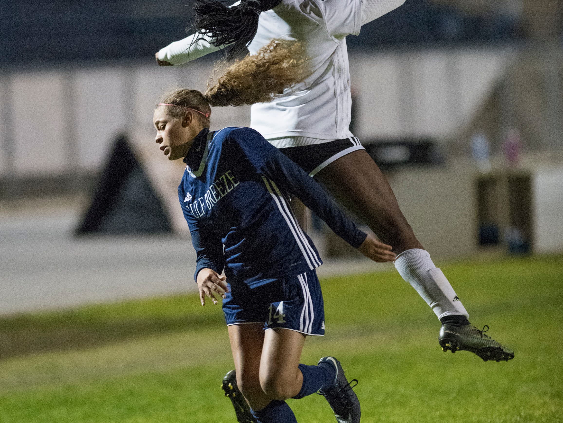 Aiyannah Robinson (14) and Kywana Donahoo (1) fight for the ball during the Niceville vs Gulf Breeze soccer game at Gulf Breeze High School on Thursday, January 10, 2019.
