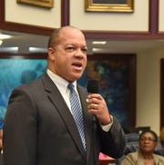 Rep. Mike Hill speaks from the floor of the Florida House of Representatives in 2015.