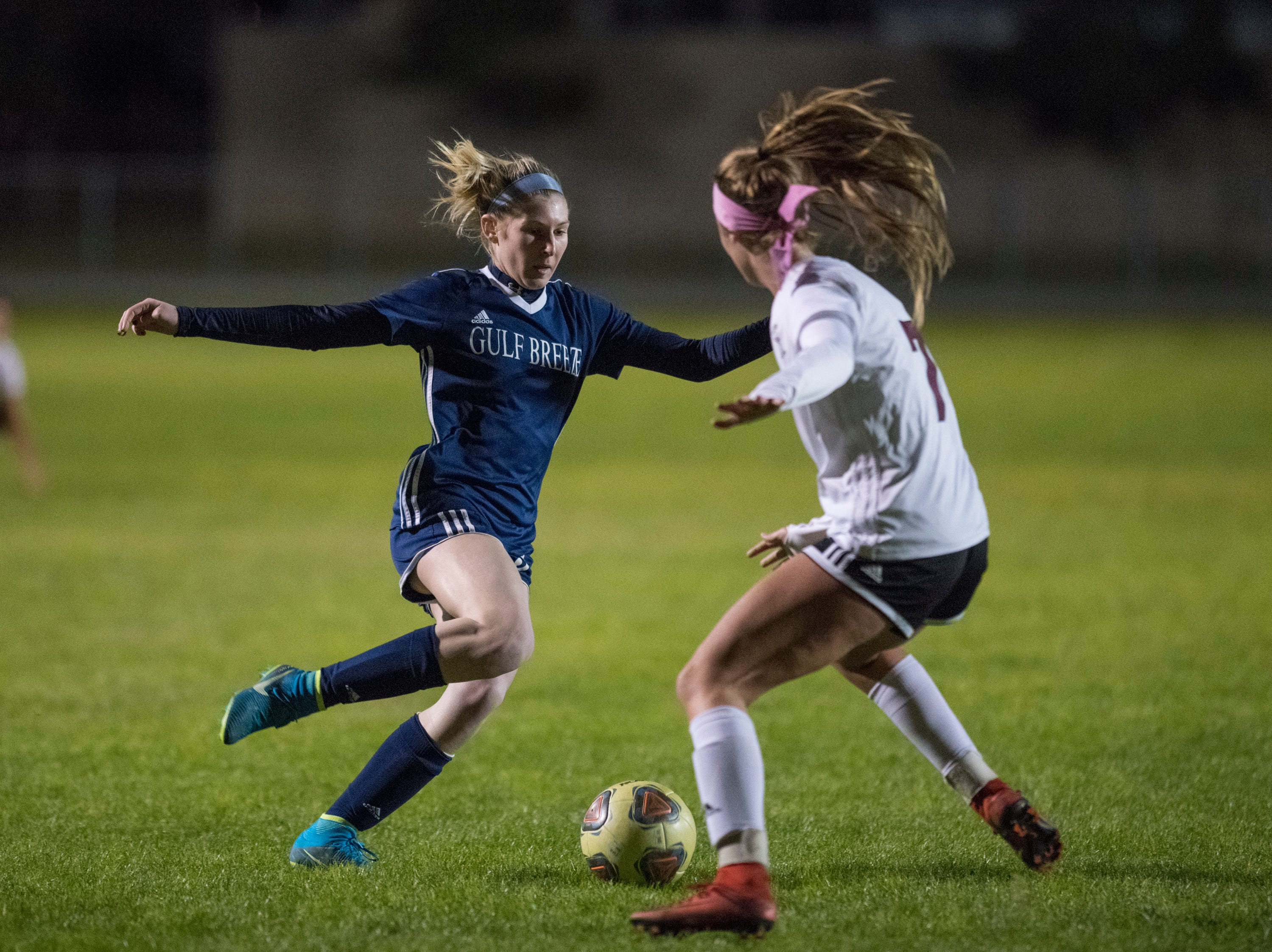 Riley Cassidy (9) tries to drive past Avery Hanson (7) during the Niceville vs Gulf Breeze soccer game at Gulf Breeze High School on Thursday, January 10, 2019.