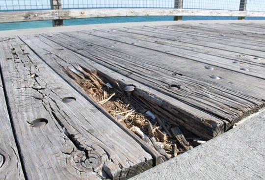 Rotting planks are seen along the Navarre Beach Fishing Pier on Jan. 11. The pier is scheduled to get re-surfacing this spring.
