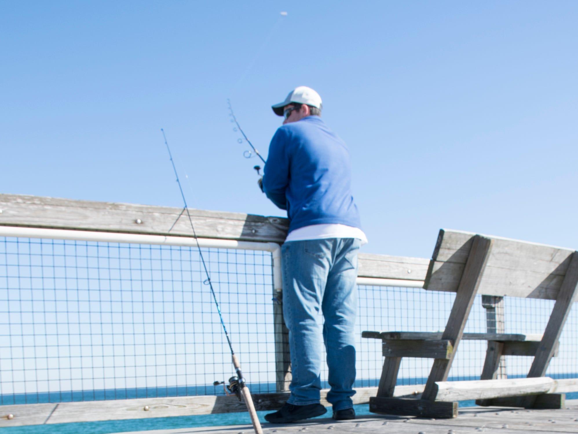 Regular angler Jonathon Cook, of Navarre, fishes from the pier in Navarre on Friday, January 11, 2019.  The pier is slated to get a major makeover this year complete with new decking material.