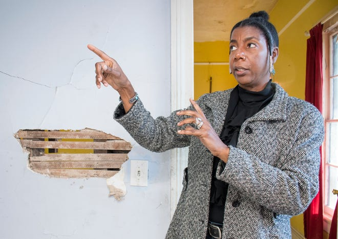 Robin Reshard talks Friday about plans for the future home of the Ezra Gerry Museum and Research Center at 422 N. Coyle Street in the Belmont-DeVilliers neighborhood of Pensacola.
