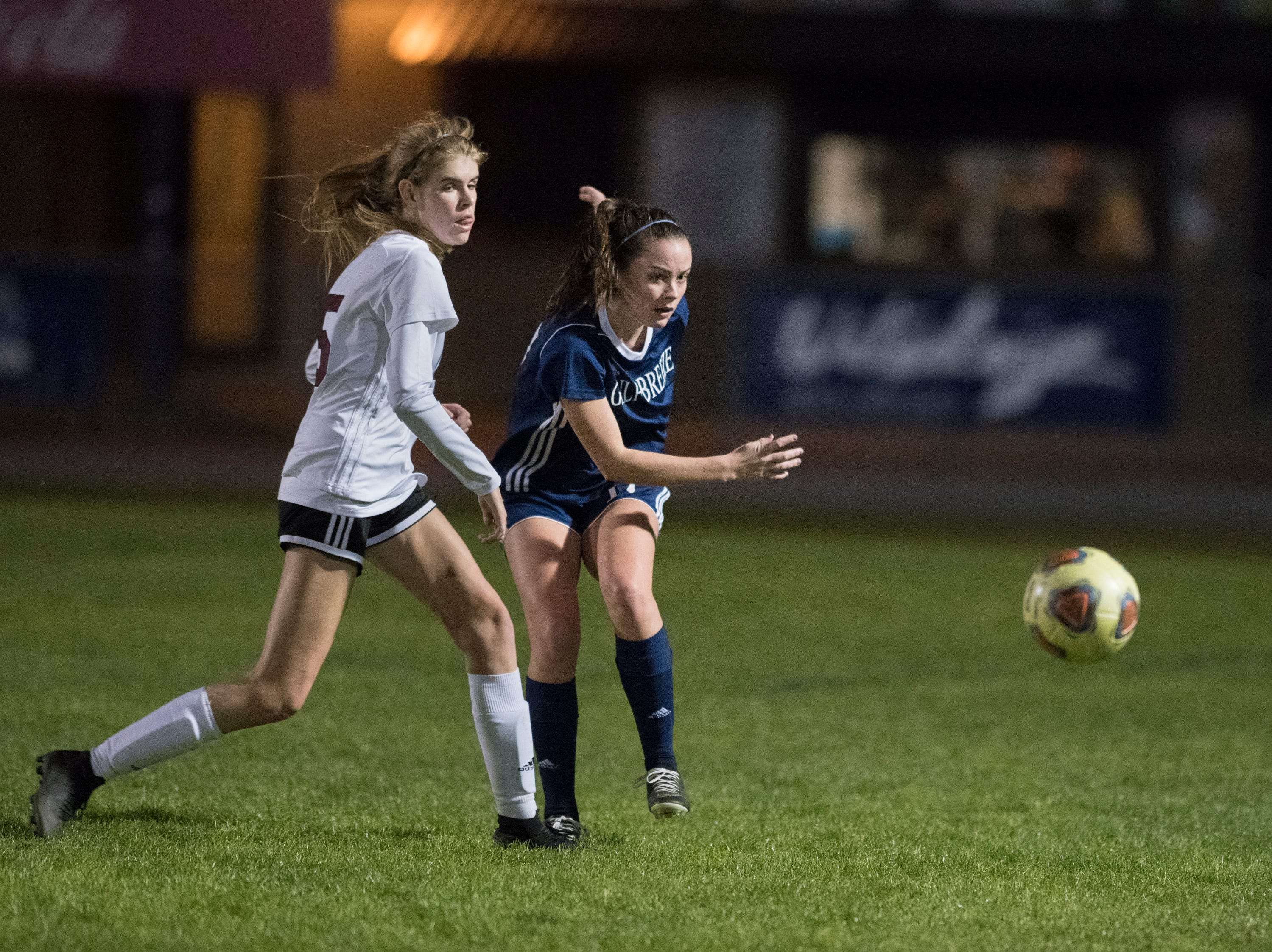 Sydney Wood (17) passes the ball during the Niceville vs Gulf Breeze soccer game at Gulf Breeze High School on Thursday, January 10, 2019.
