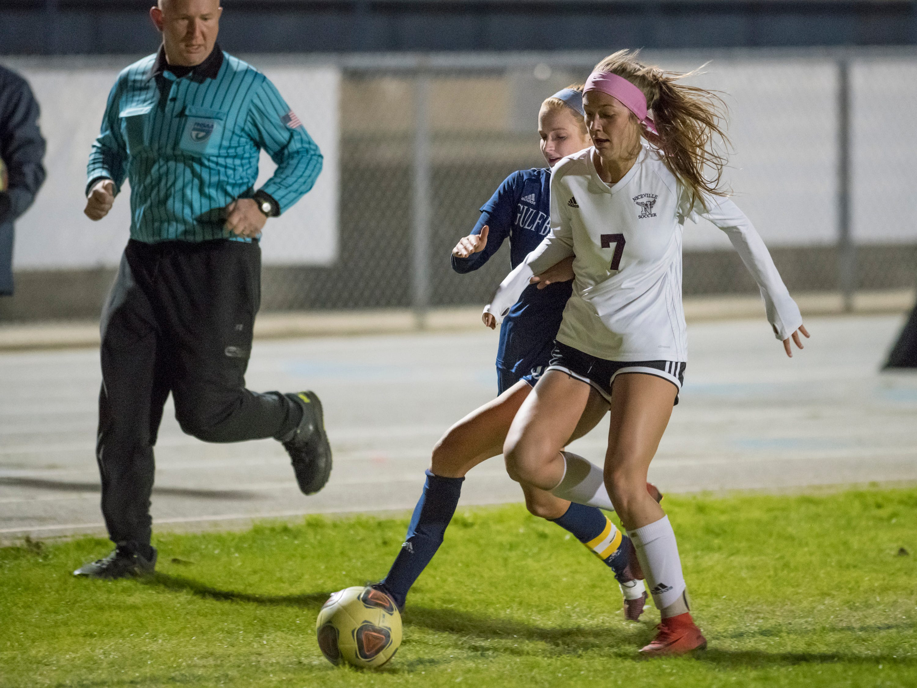 Kristen Goodroe (20)  and Avery Hanson (7) fight for the ball during the Niceville vs Gulf Breeze soccer game at Gulf Breeze High School on Thursday, January 10, 2019.