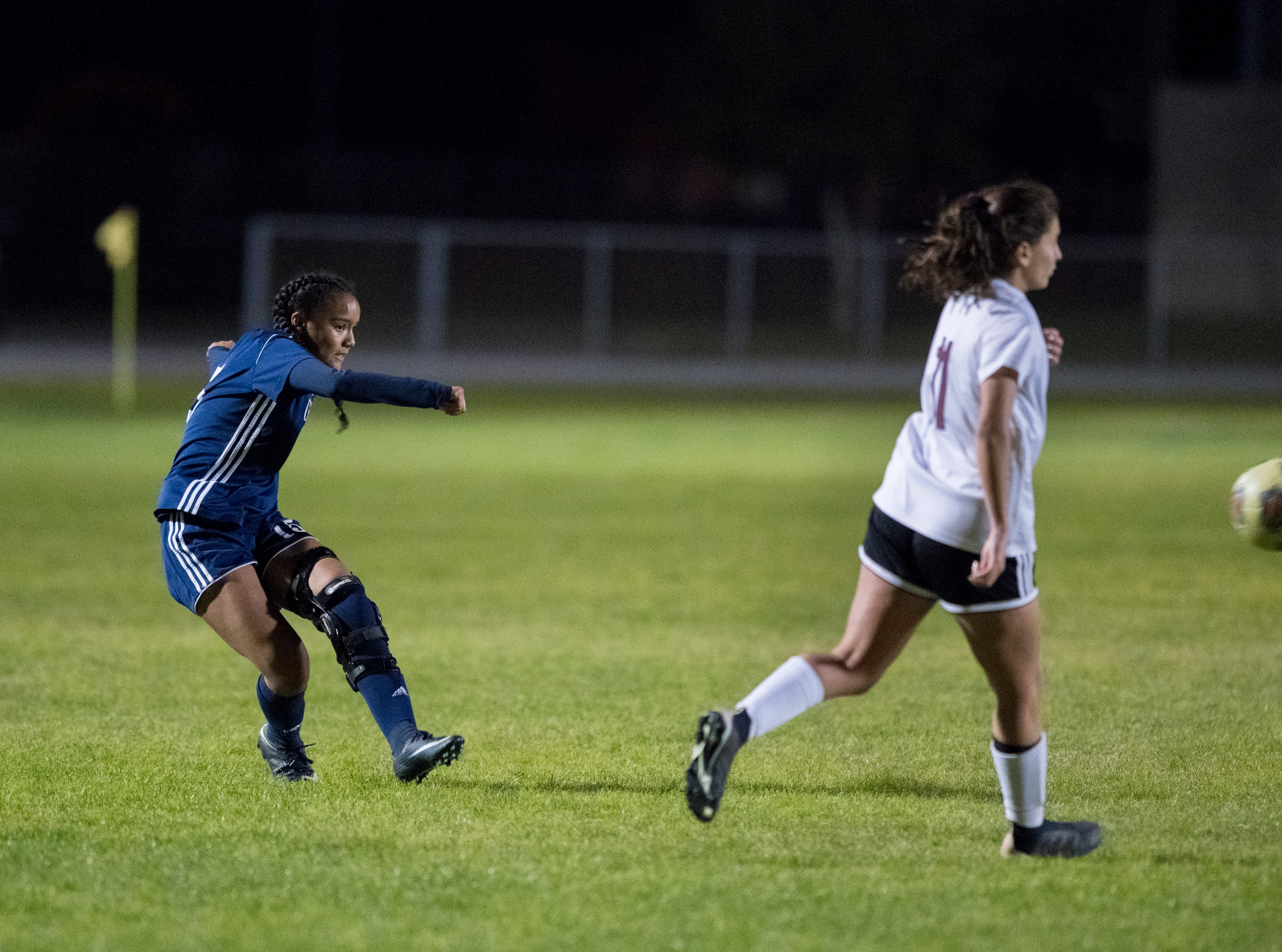 Aila Swinton (15) passes the ball during the Niceville vs Gulf Breeze soccer game at Gulf Breeze High School on Thursday, January 10, 2019.