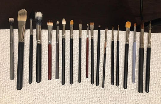 Use mild soap or brush cleaner and wash each brush until all makeup residue is gone. Reshape brushes