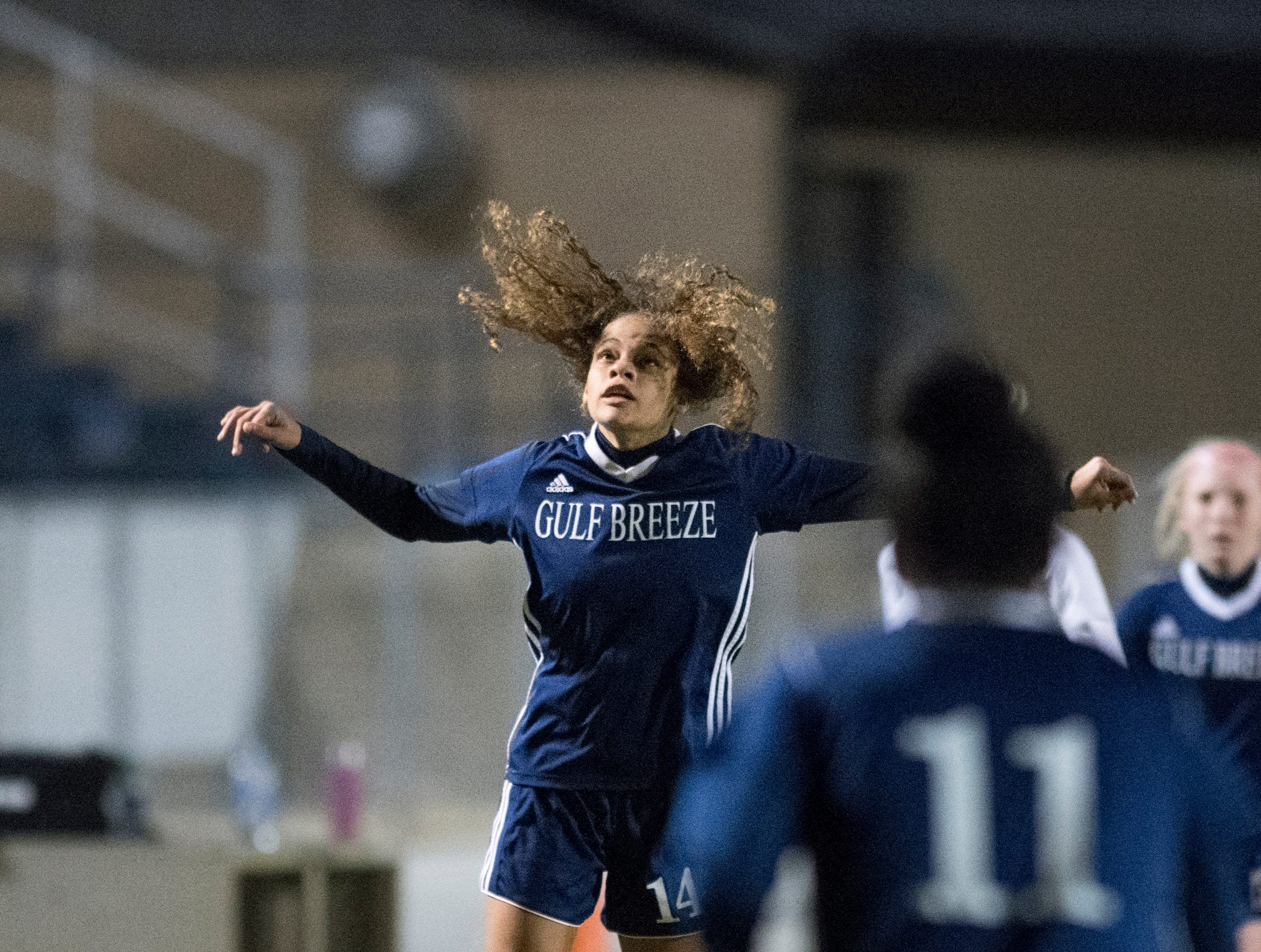 Aiyannah Robinson (14) leaps to head the ball during the Niceville vs Gulf Breeze soccer game at Gulf Breeze High School on Thursday, January 10, 2019.