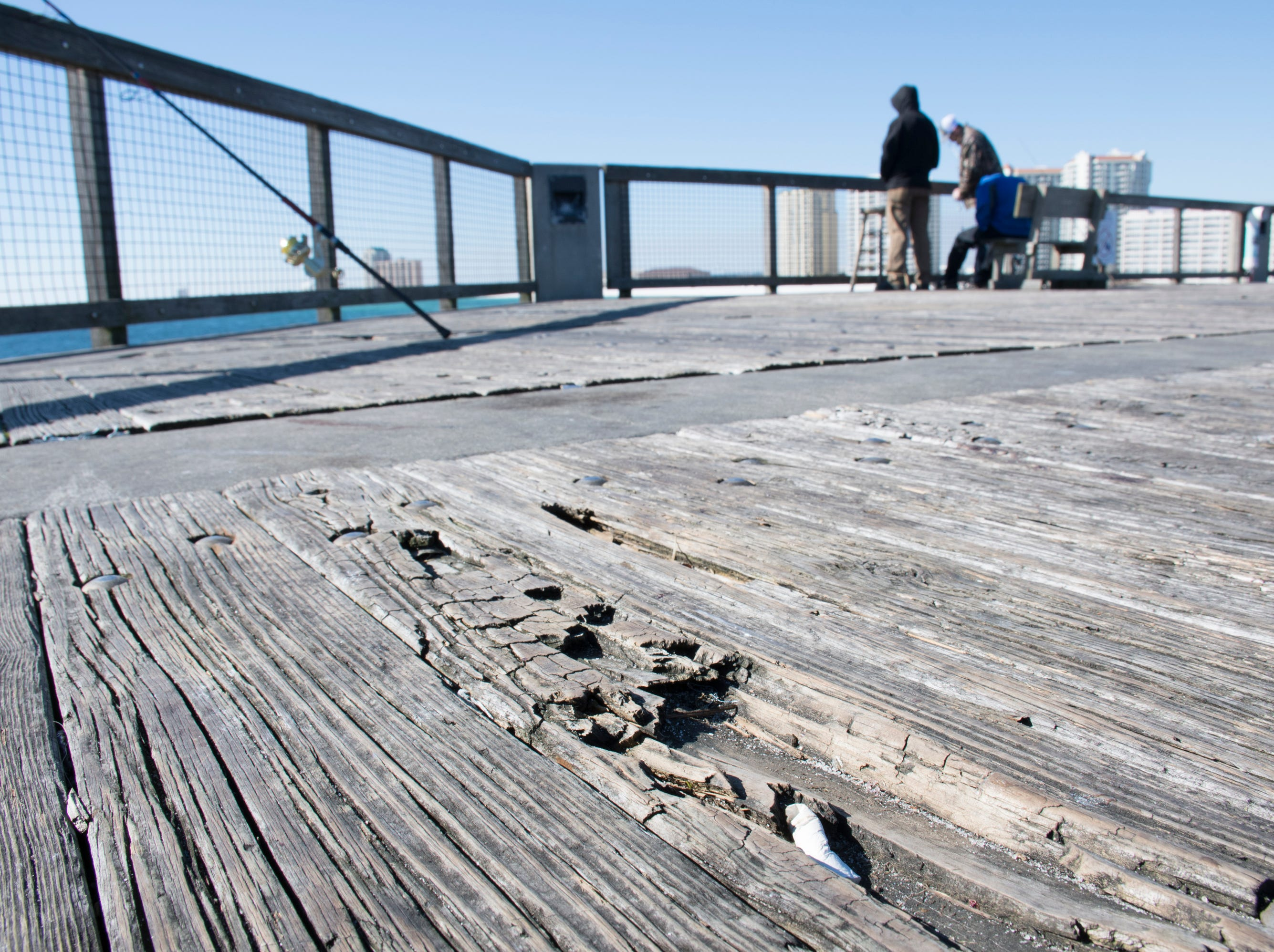 Anglers fish from the pier in Navarre on Friday, January 11, 2019.  The pier is slated to get a major makeover this year complete with new decking material.