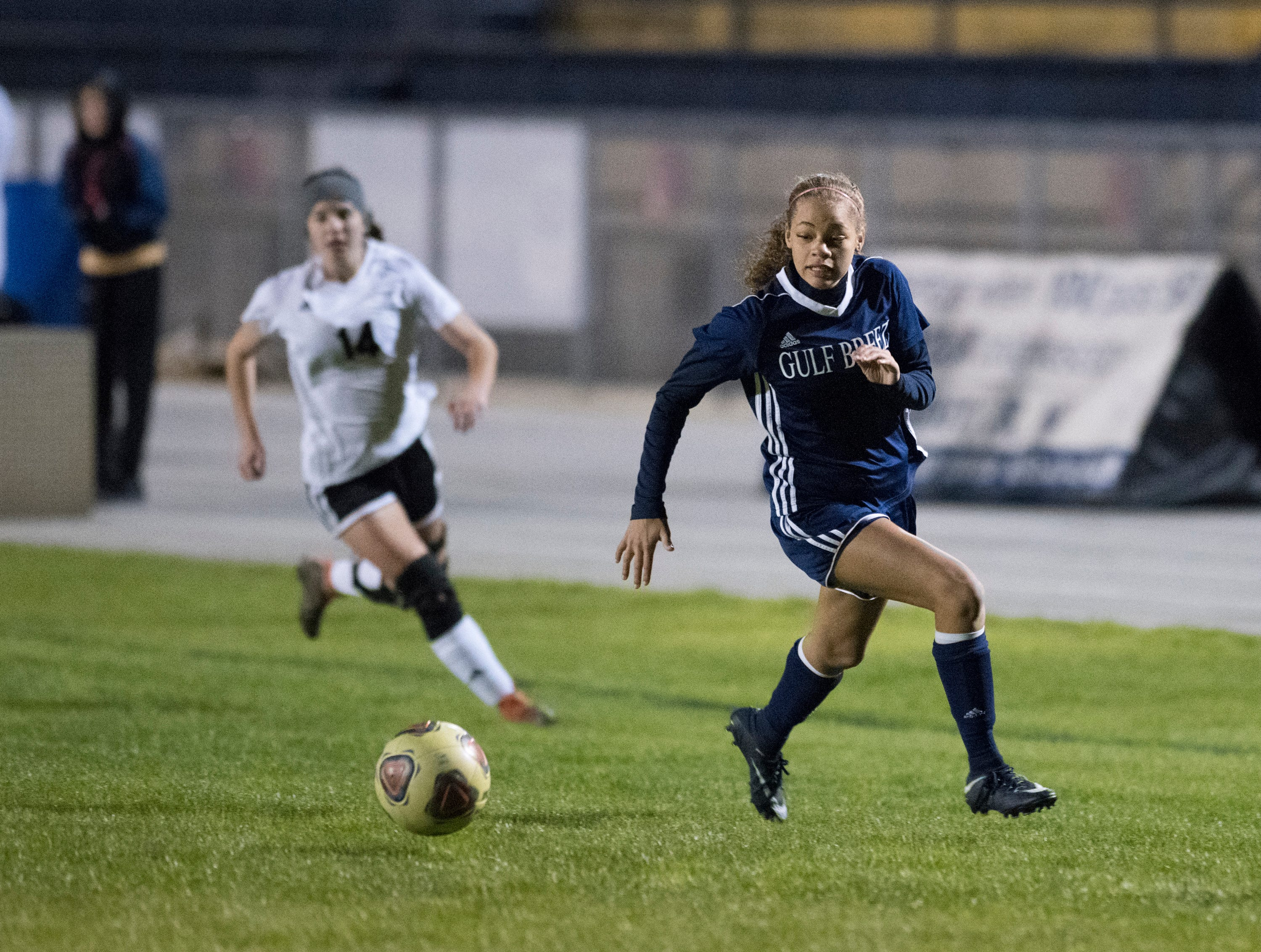 Aiyannah Robinson (14) races to the ball during the Niceville vs Gulf Breeze soccer game at Gulf Breeze High School on Thursday, January 10, 2019.