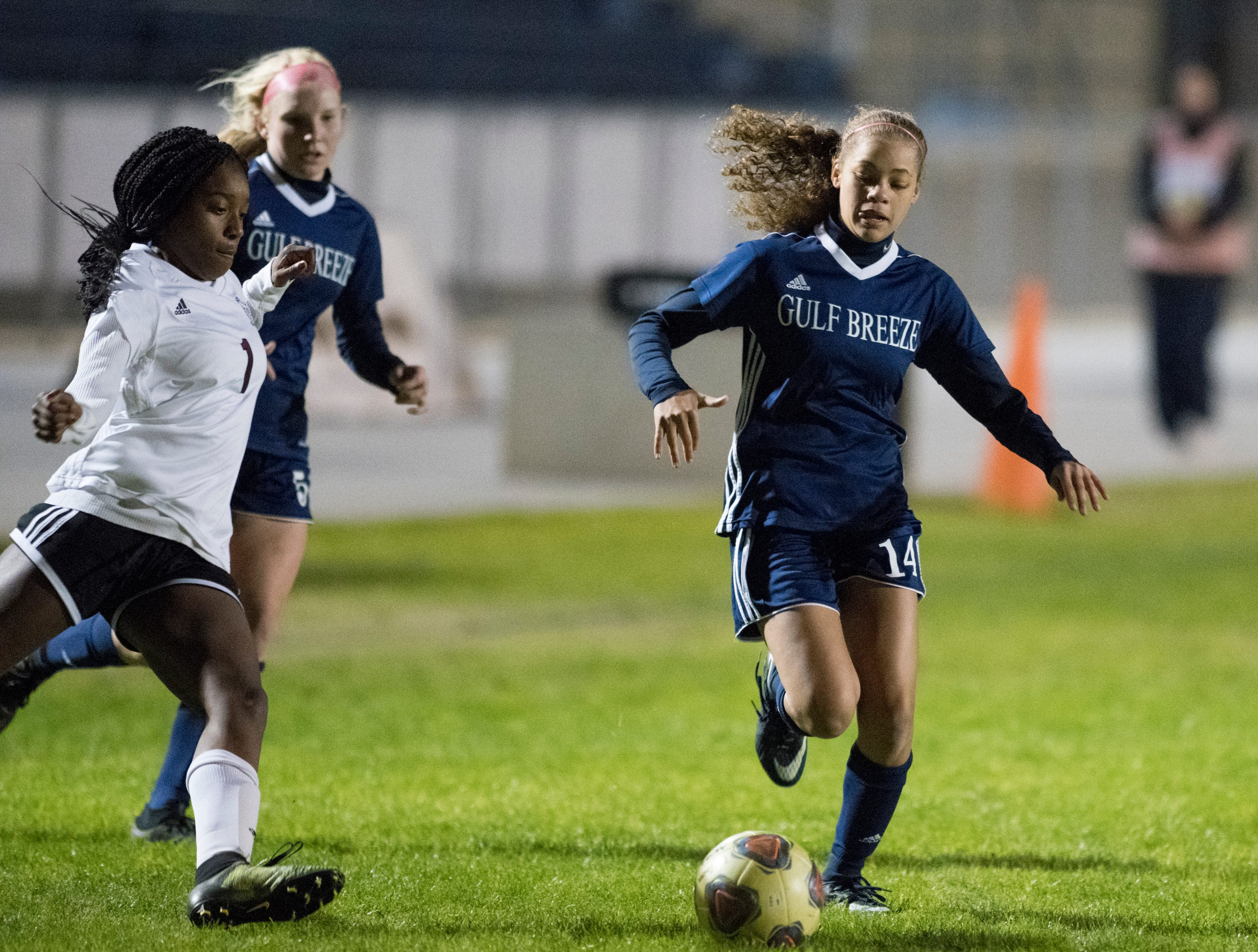Aiyannah Robinson (14) dribbles the ball during the Niceville vs Gulf Breeze soccer game at Gulf Breeze High School on Thursday, January 10, 2019.