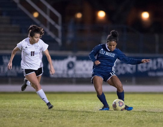 Mya Swinton (11) controls the ball during the Niceville vs Gulf Breeze soccer game at Gulf Breeze High School on Thursday, January 10, 2019.