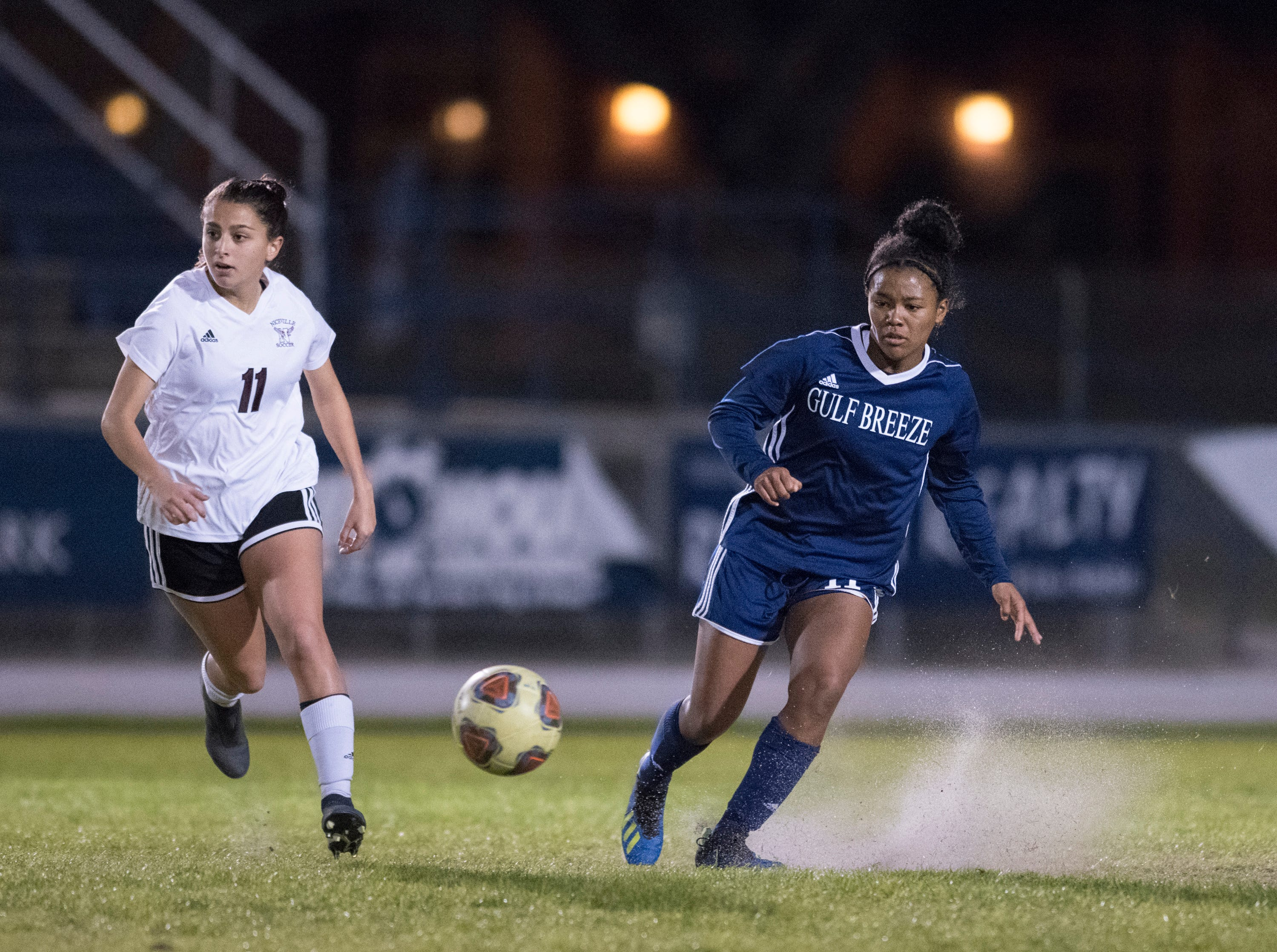 Mya Swinton (11) passes the ball during the Niceville vs Gulf Breeze soccer game at Gulf Breeze High School on Thursday, January 10, 2019.