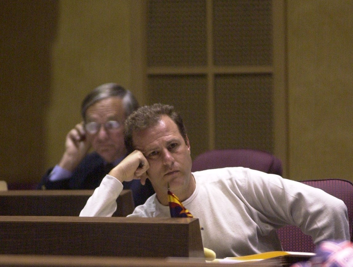 Senators (foreground) Jay Tibshraeny from District 21 and (background) Harry Mitchell from District 17 meet in chambers on May 16, 2003.