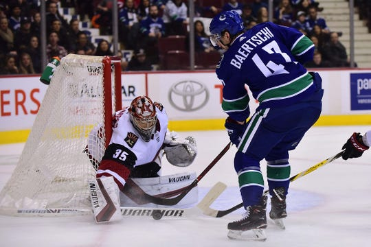 Jan 10, 2019; Vancouver, British Columbia, CAN; Arizona Coyotes goaltender Darcy Kuemper (35) blocks a shot by Vancouver Canucks forward Sven Baertschi (47) during the first period at Rogers Arena. Mandatory Credit: Anne-Marie Sorvin-USA TODAY Sports