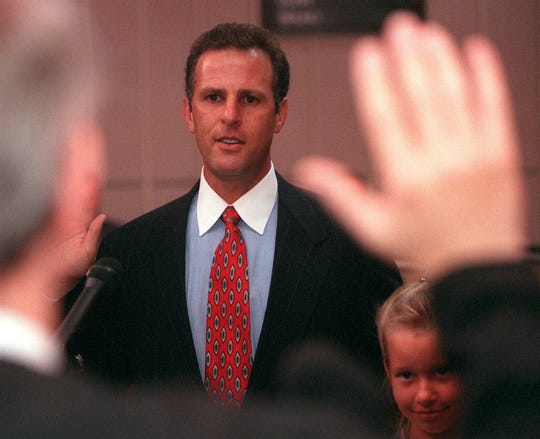 Chandler Mayor Jay Tibshraeny is sworn into office by Judge Michael Traynor  on June 11, 1998. Tibshraeny's daughter Lauren looks on.