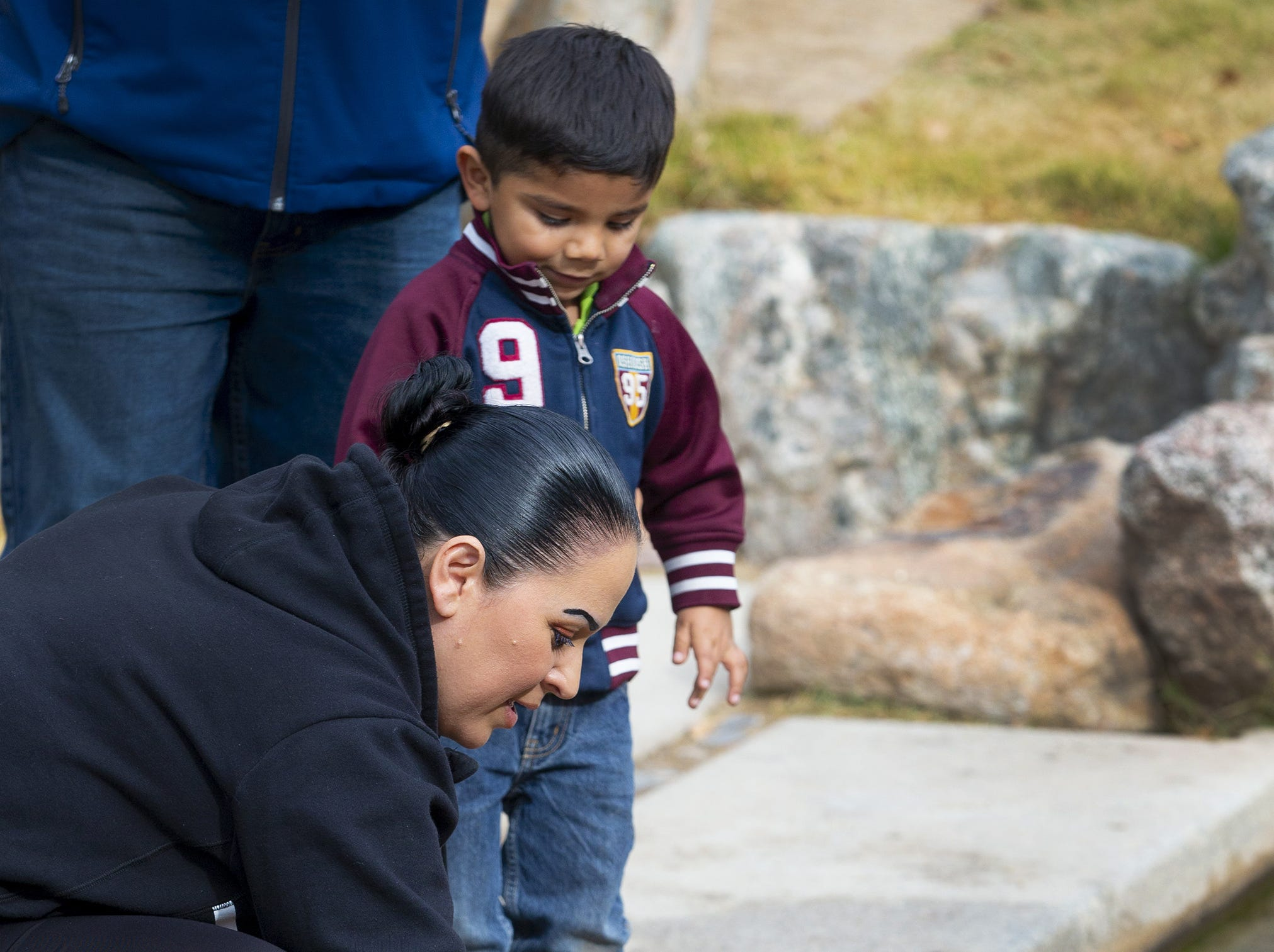 Angelica Munoz and her son, Carlos Jr., 3, of Buckeye, feed the koi fish at the Japanese Friendship Garden located in the heart of downtown Phoenix on January 10, 2019.