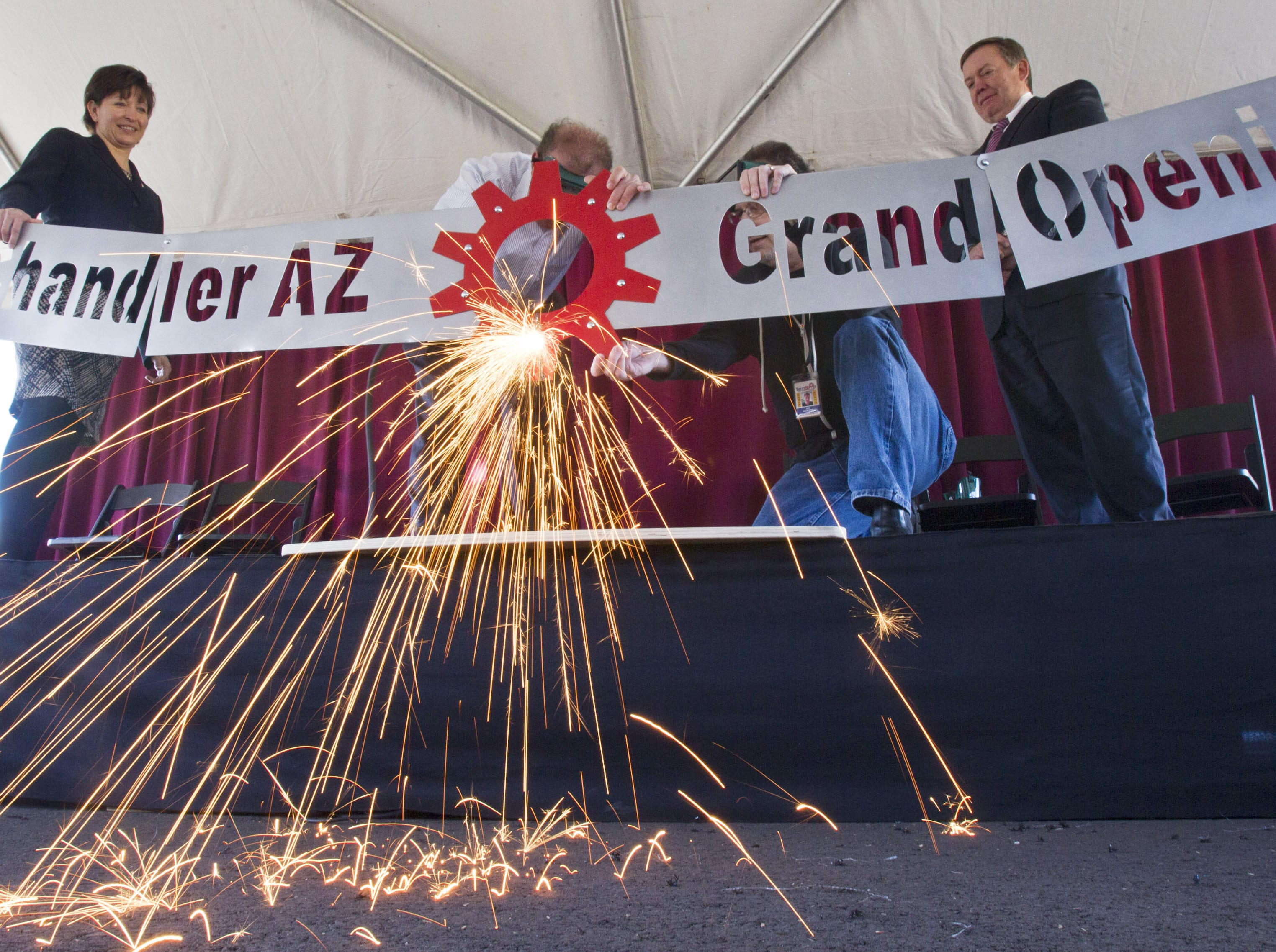 Chandler Mayor Jay Tibshraeny cuts a steel ribbon with a plasma torch in 2014 for the opening of the TechShop, a creative space where ASU students and the general public has access to a bevy of high-tech tools and gadgets.