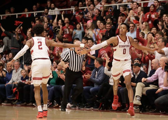 Stanford forward KZ Okpala (0) is congratulated by guard Bryce Wills (2) after scoring against Arizona during the second half of an NCAA college basketball game in Stanford, Calif., Wednesday, Jan. 9, 2019. (AP Photo/Jeff Chiu)