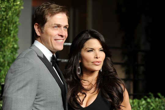 Patrick Whitesell and Lauren Sanchez arrive at the Vanity Fair Oscar party on Feb.27, 2011, in West Hollywood, California.